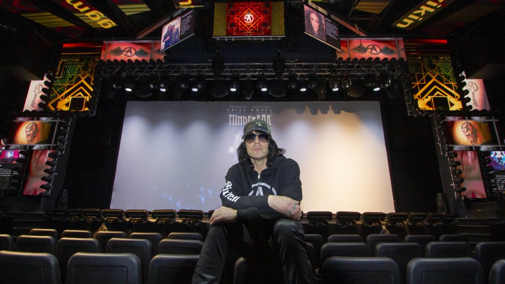 Criss Angel, shown at the Mindfreak theater in Las Vegas, has a higher purpose.