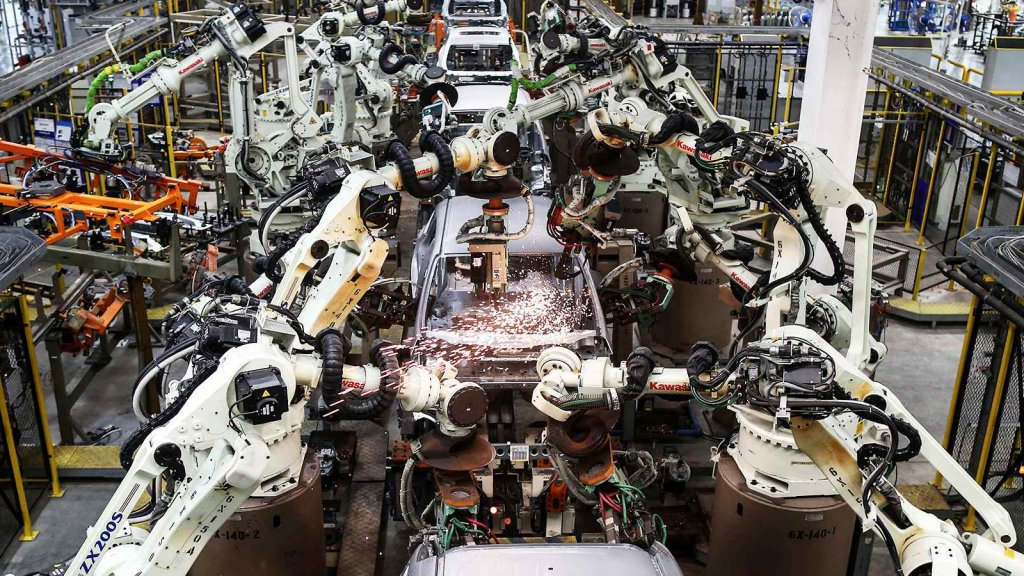 Welding robots operate on the cockpits of Ford Focus vehicles as they move through the body shop station at the Ford Motor Co. factory in the Hemaraj Eastern Seaboard Industrial Estate in Pluak Daeng district, Rayong province, Thailand.