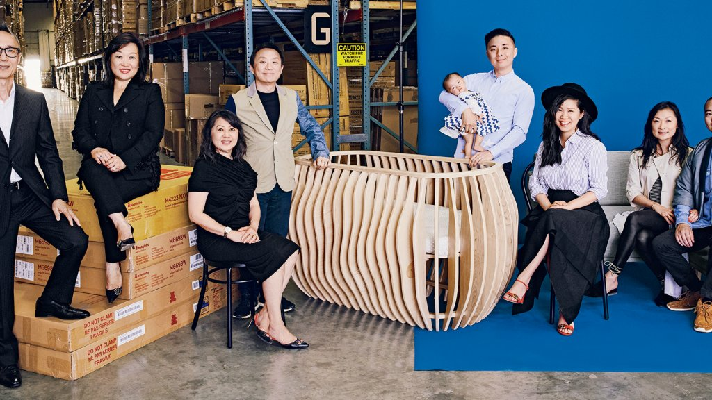 John Kwok (left), Julia Fong Yip, Maryann Fong, Daniel Fong, baby Sophie Fong, Teddy Fong, Tiffany Fong, Tracy Fong and Eric Lin. The Montebello warehouse holds inventory of its $7,500 Gradient crib, along with sofas from its new startup, Capsule Home.