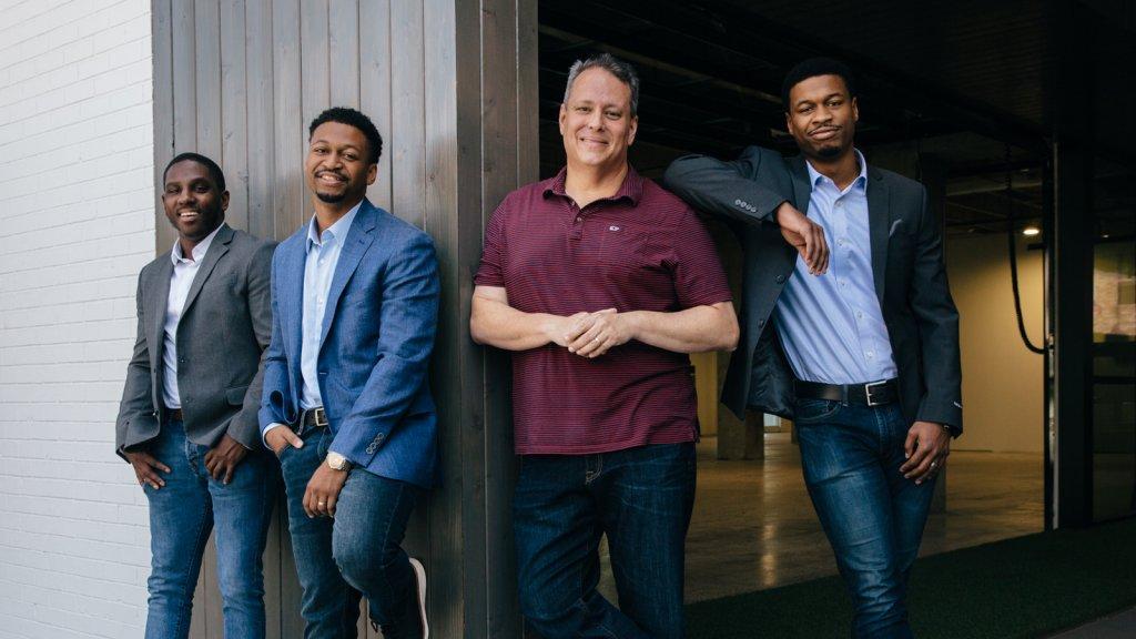 From left: Keran Smith, Lyfe Marketing CMO, Sean Standberry, Lyfe Marketing CEO, Rob Frohwein, Kabbage CEO, Sherman Standberry, Lyfe Marketing CFO.