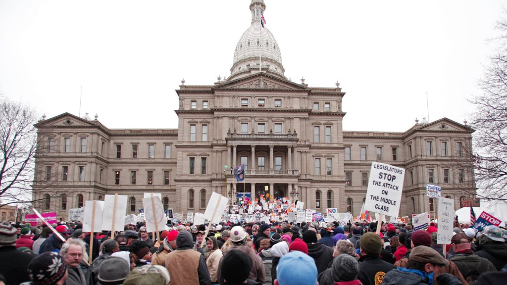 Union members from around the country rally at the Michigan State Capitol to protest a vote on Right-to-Work legislation December 11, 2012 in Lansing, Michigan.