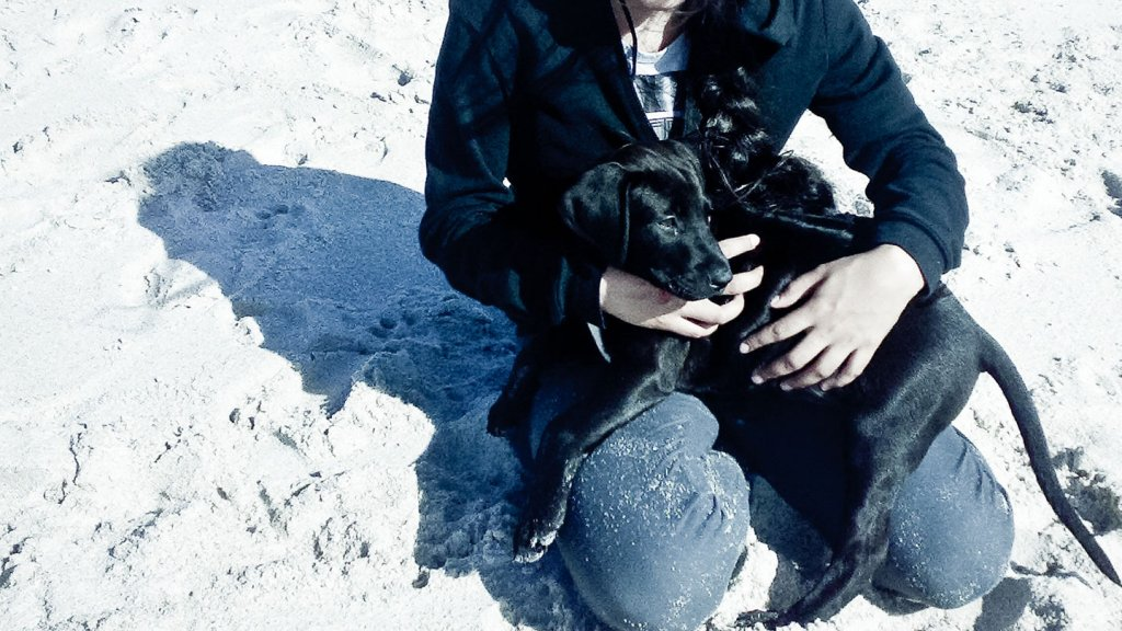 facebook profile picture, woman with black dog