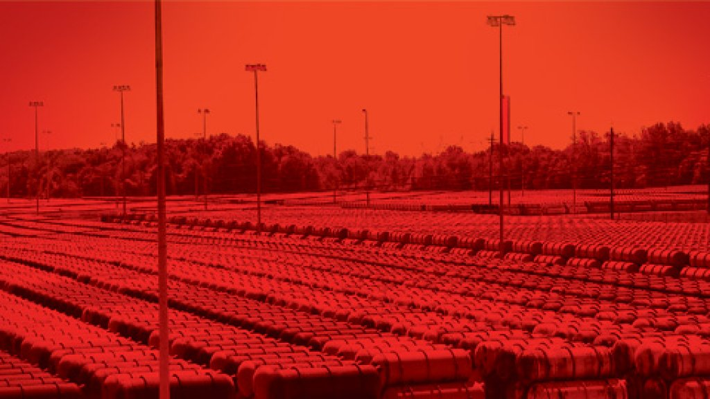 Some of the 36,000 canisters at the Department of Energy's cylinder yard in Paducah, Kentucky. Each cylinder is roughly 12 feet by 4 feet; the depleted uranium inside them is the byproduct of uranium enrichment.