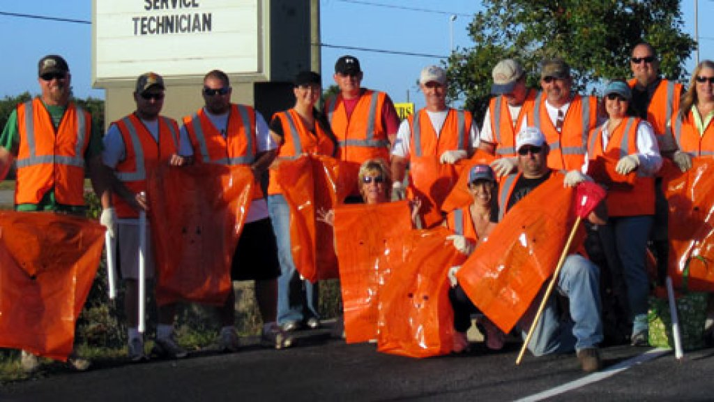 On top of an emphasis on leadership, Symbiont Service Corp. also celebrates community service, paying wages for up to five hours of community service for each employee. Above, volunteers from Symbiont participate in Adopt A Highway for the three-mile span outside their offices.