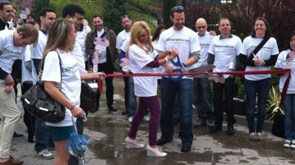 Amilya Antonetti and Gary Whitehill kick off Entrepreneur Walk with a ribbon-cutting.