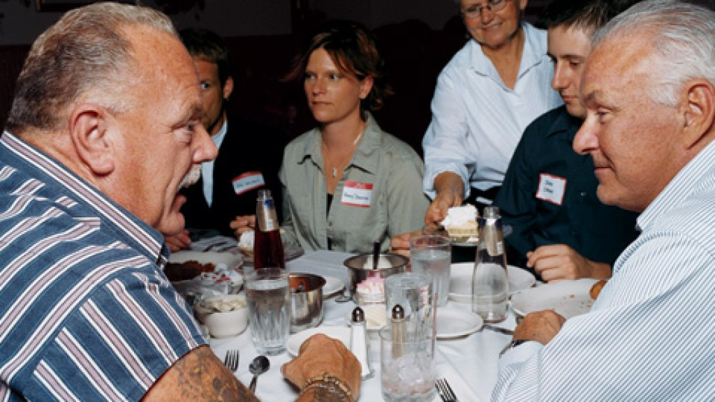 <strong>The Working Man's Tycoon</strong> Having addressed the Edgerton, Wisconsin Chamber of Commerce, and indulged in the fried chicken at the Lake House Inn, Ken Hendricks (right) talks business with chamber member Bill Collins.