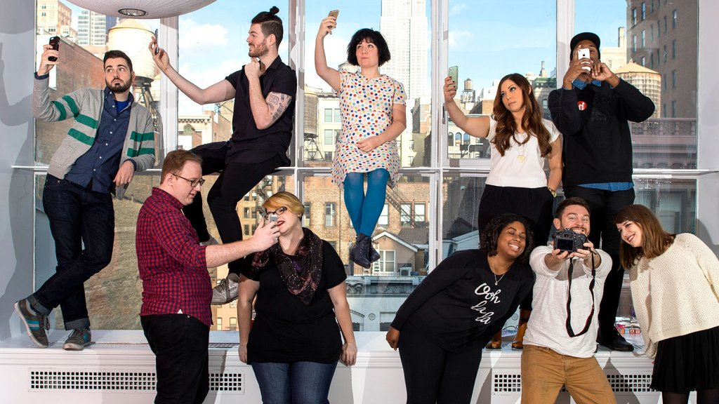 A BuzzFeed team has some fun with apps at their New York City office.