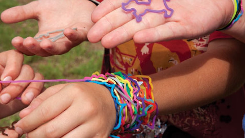 Kids trade Silly Bandz at a local Austin park. The brightly colored rubber bands are shaped like dinosaurs, musical instruments, animals and many other shapes.