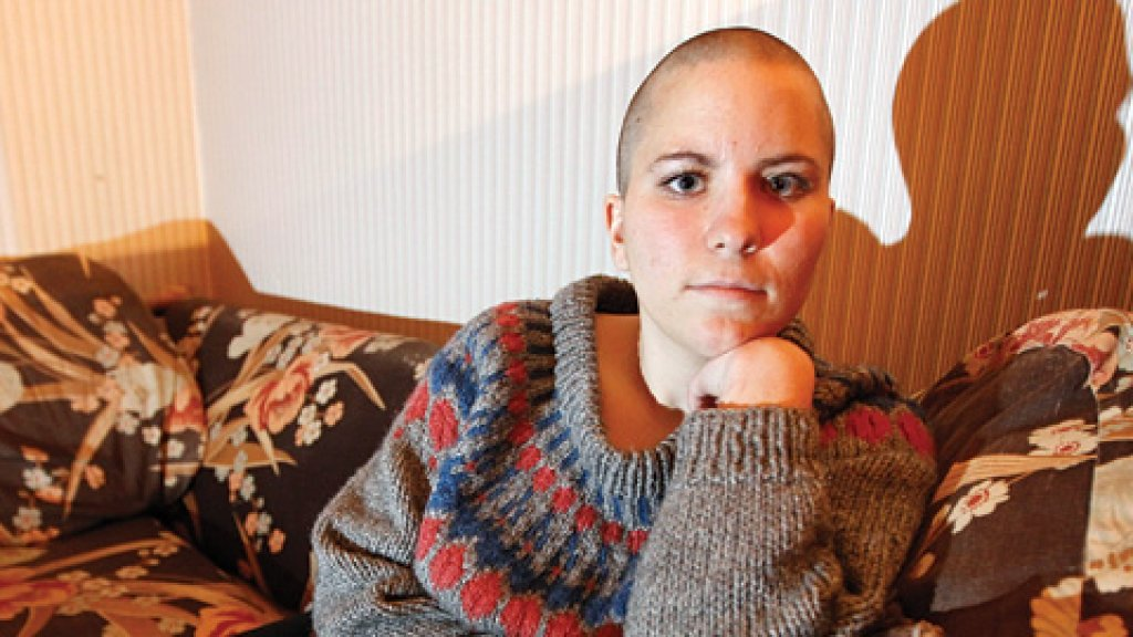 Stephanie Lozinski said she was shocked by her firing because she'd let her bosses know of her plans to shave her head.