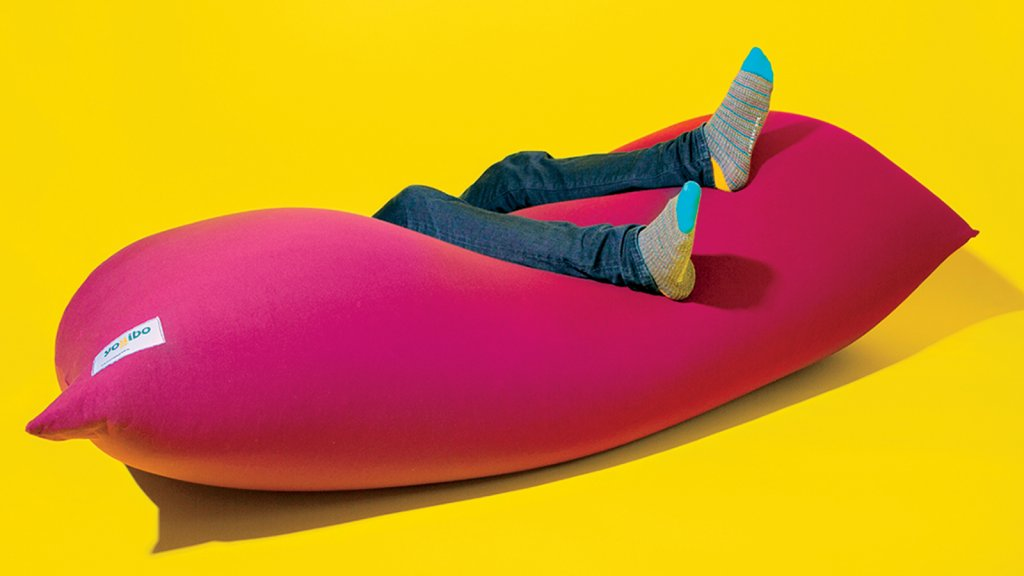 A Yogibo beanbag chair in action. Its playful and unusual shape invites a customer to try it out before buying.