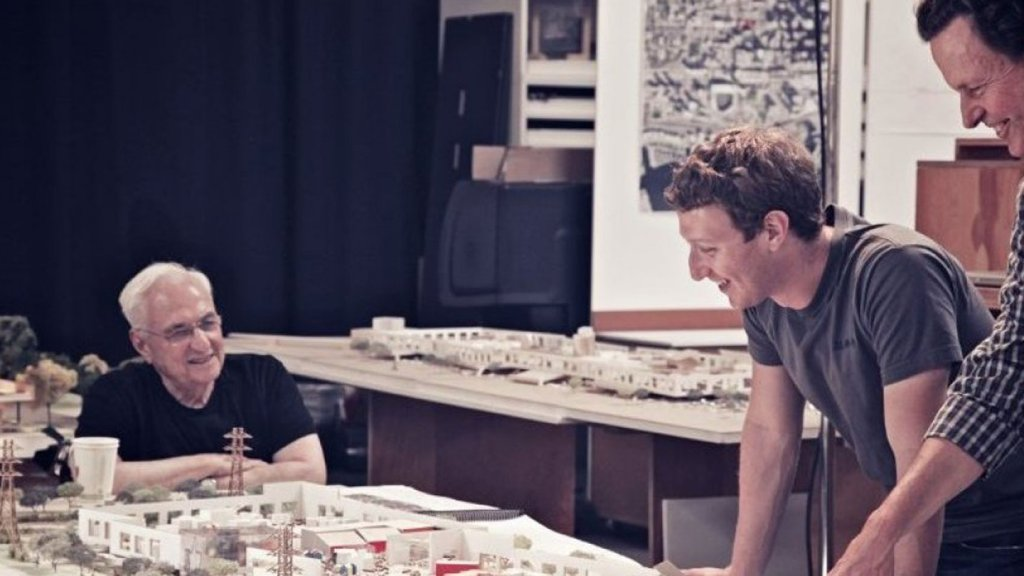 Facebook founder Mark Zuckerberg and architect Frank Gehry look over the plans.