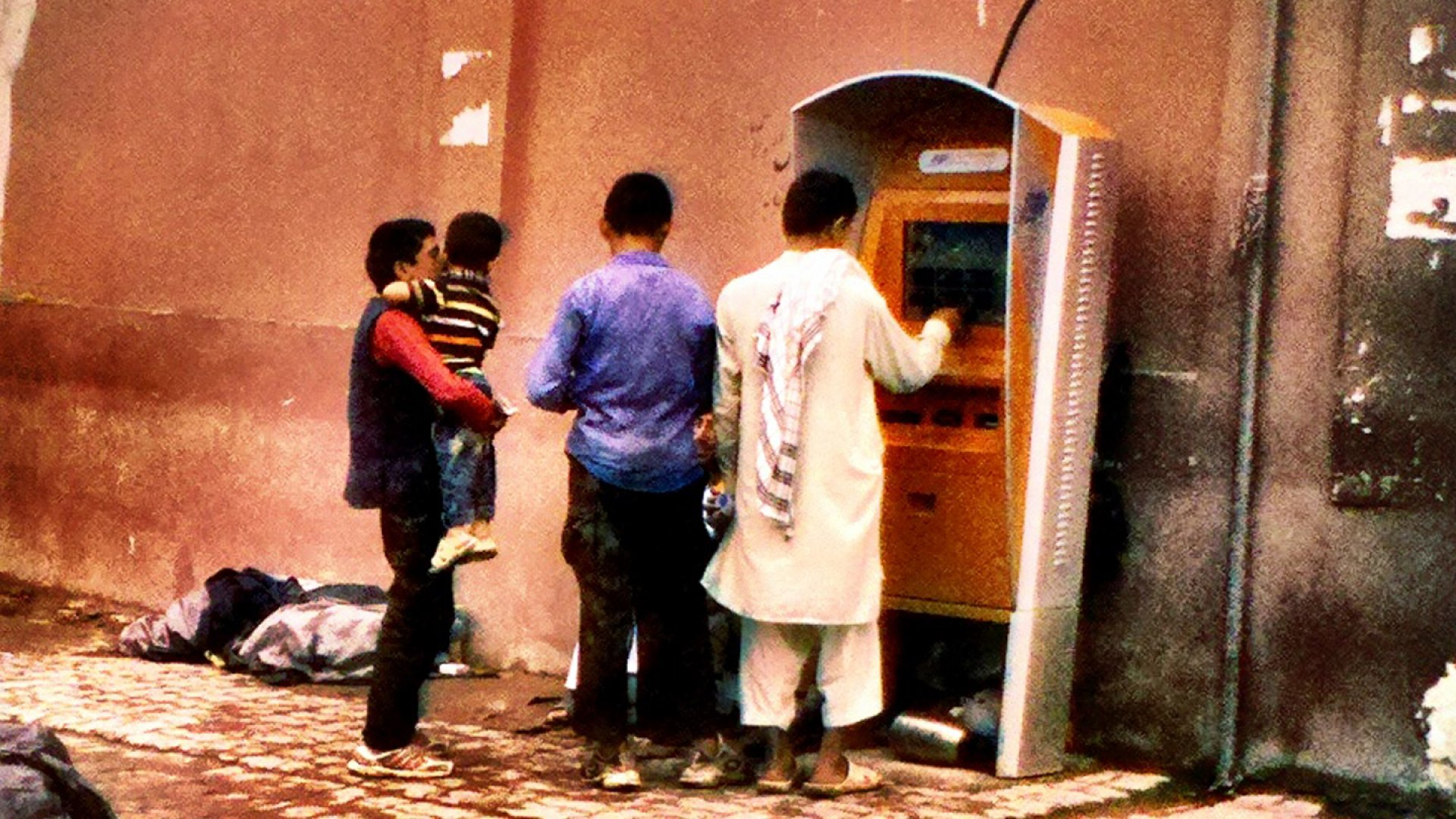 Customers in Kabul, Afghanistan, use a Marikh Tech payment kiosk.