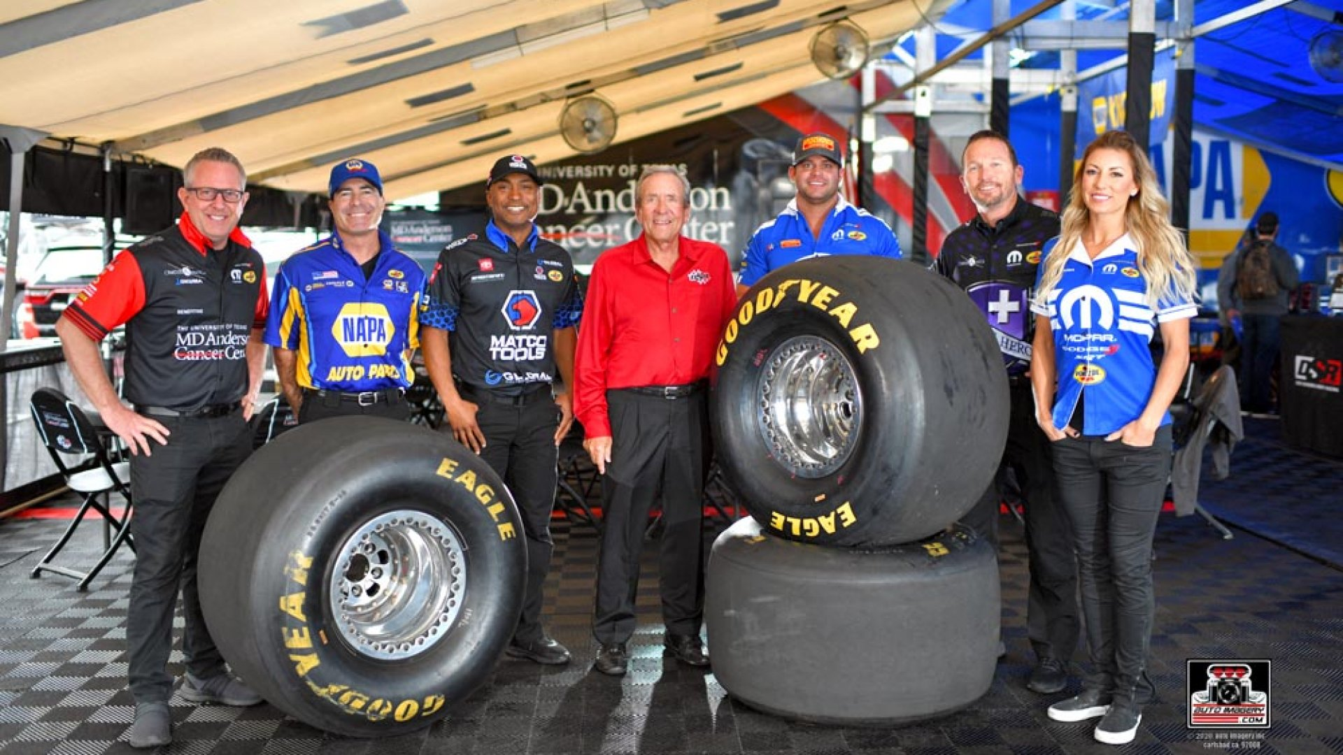 Don Schumacher, center, with (left to right) drivers Tommy Johnson, Jr., Ron Capps, Antron Brown, Matt Hagan, Jack Breckman and Leah Pruett.
