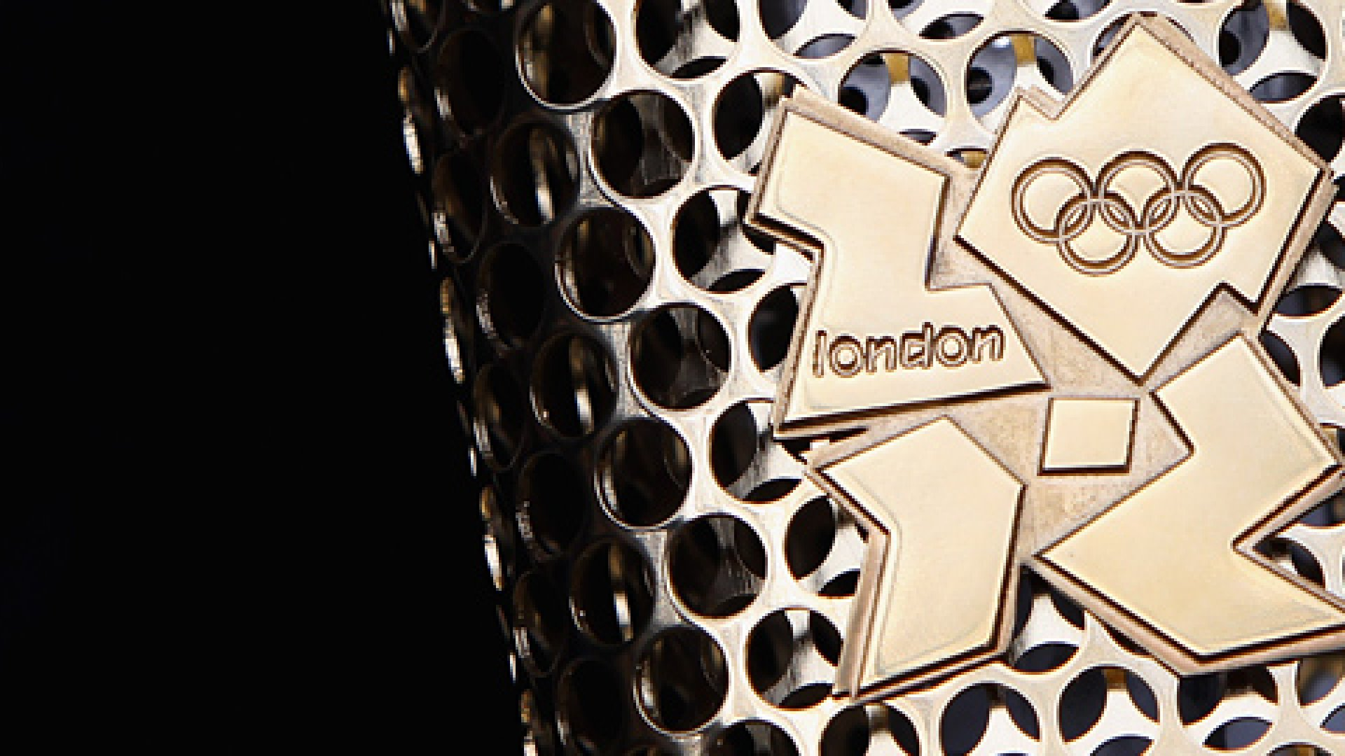 Barber Osgerby's design for the 2012 Olympic torch features 8,000 holes, symbolizing the 8,000 torchbearers.