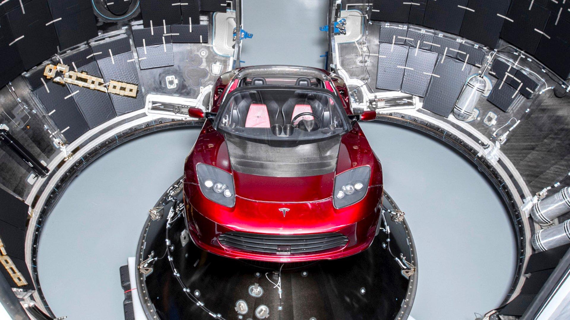 A red Tesla Roadster loaded in SpaceX's Falcon Heavy rocket.