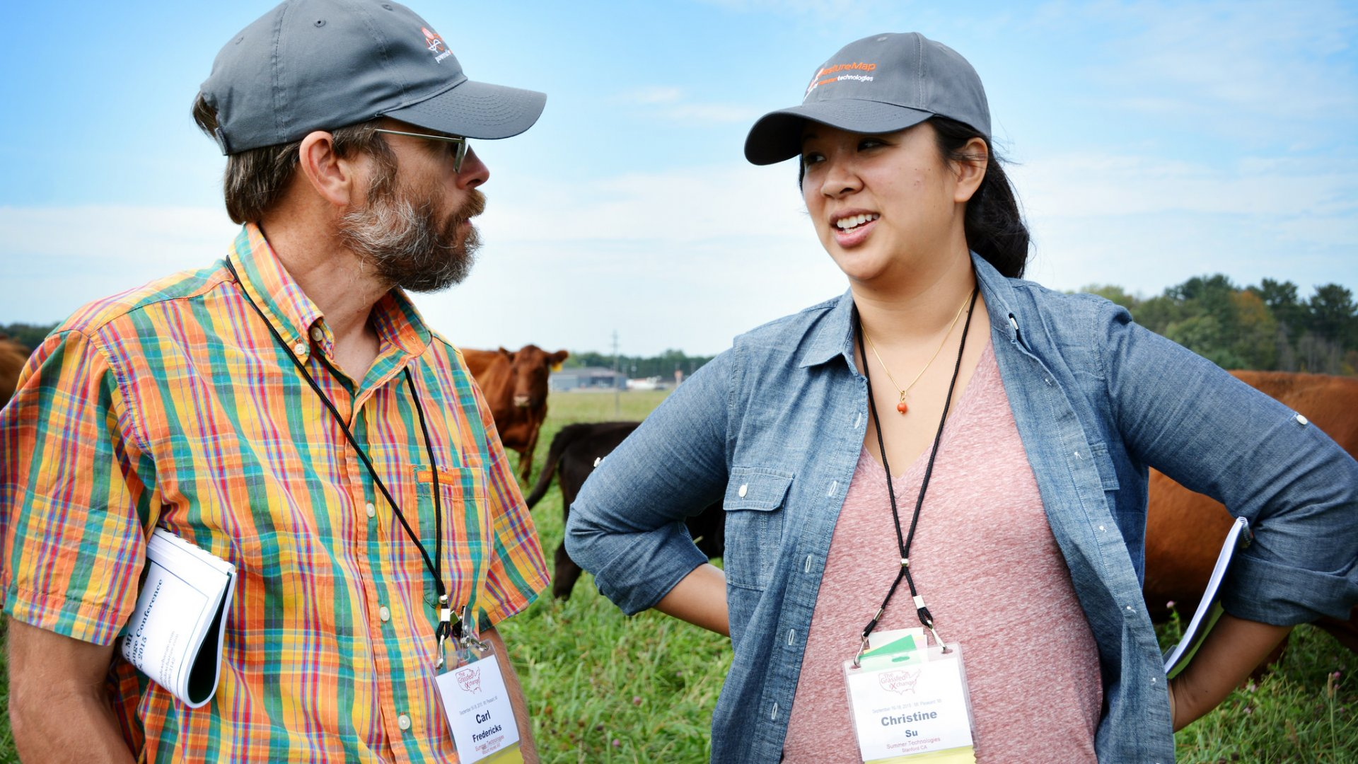 Christine Su, founder of PastureMap and a 2016 Echoing Green fellow, discusses optimal grass species with a grazing consultant.