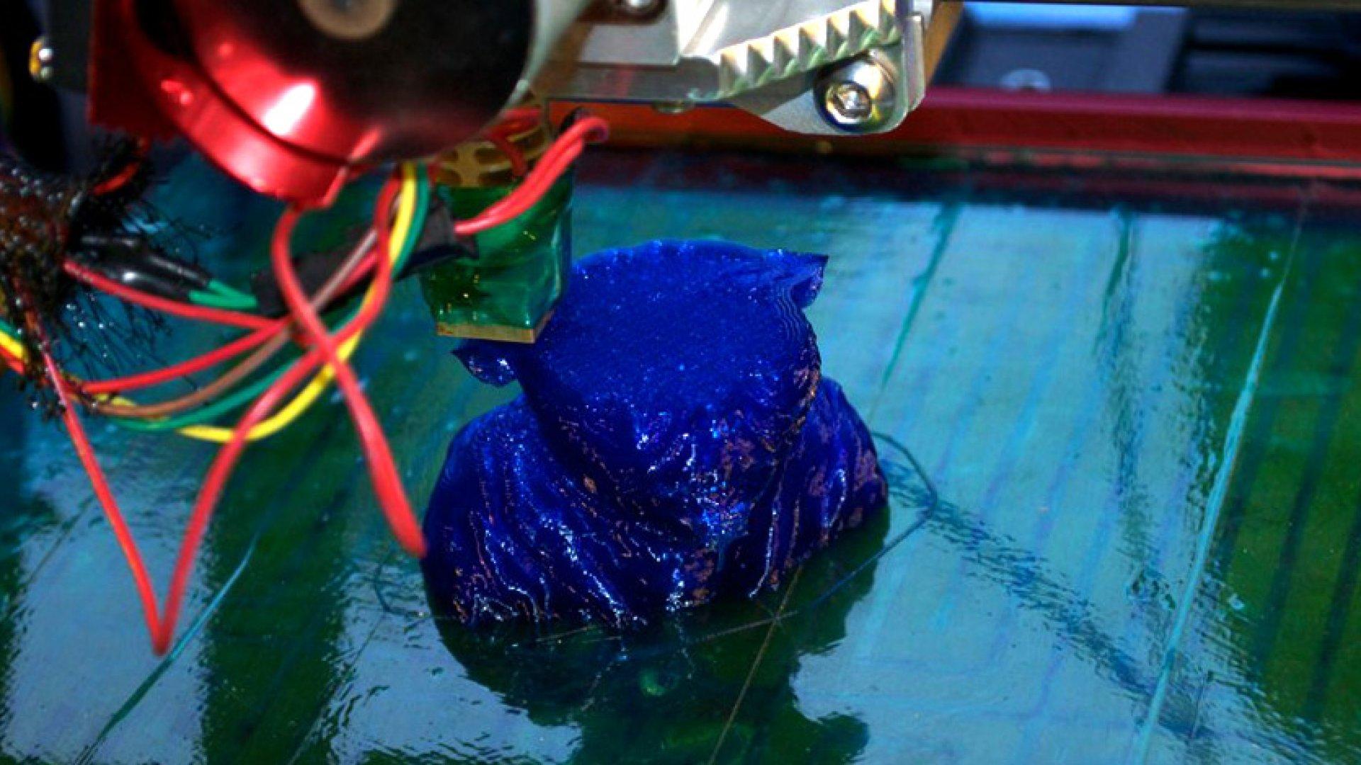 A 3-D printer at work.