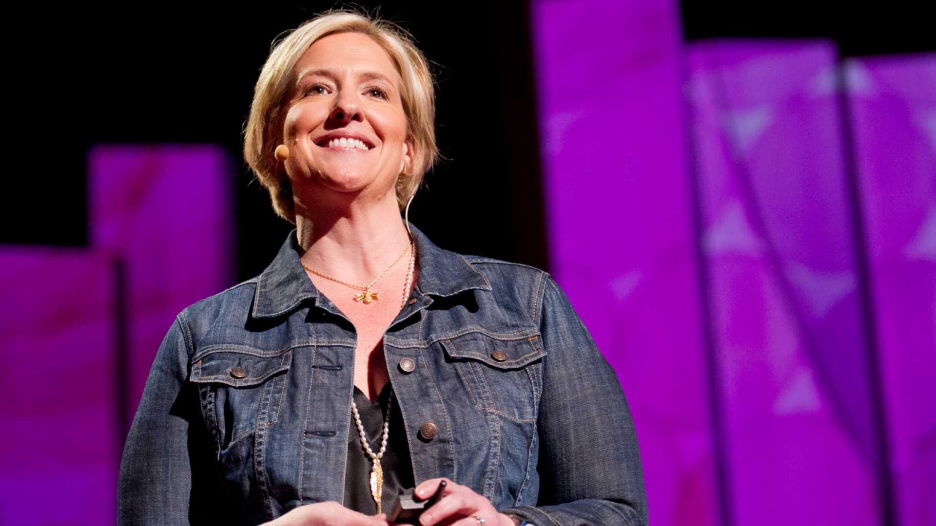 Author Brené Brown giving a TED Talk.