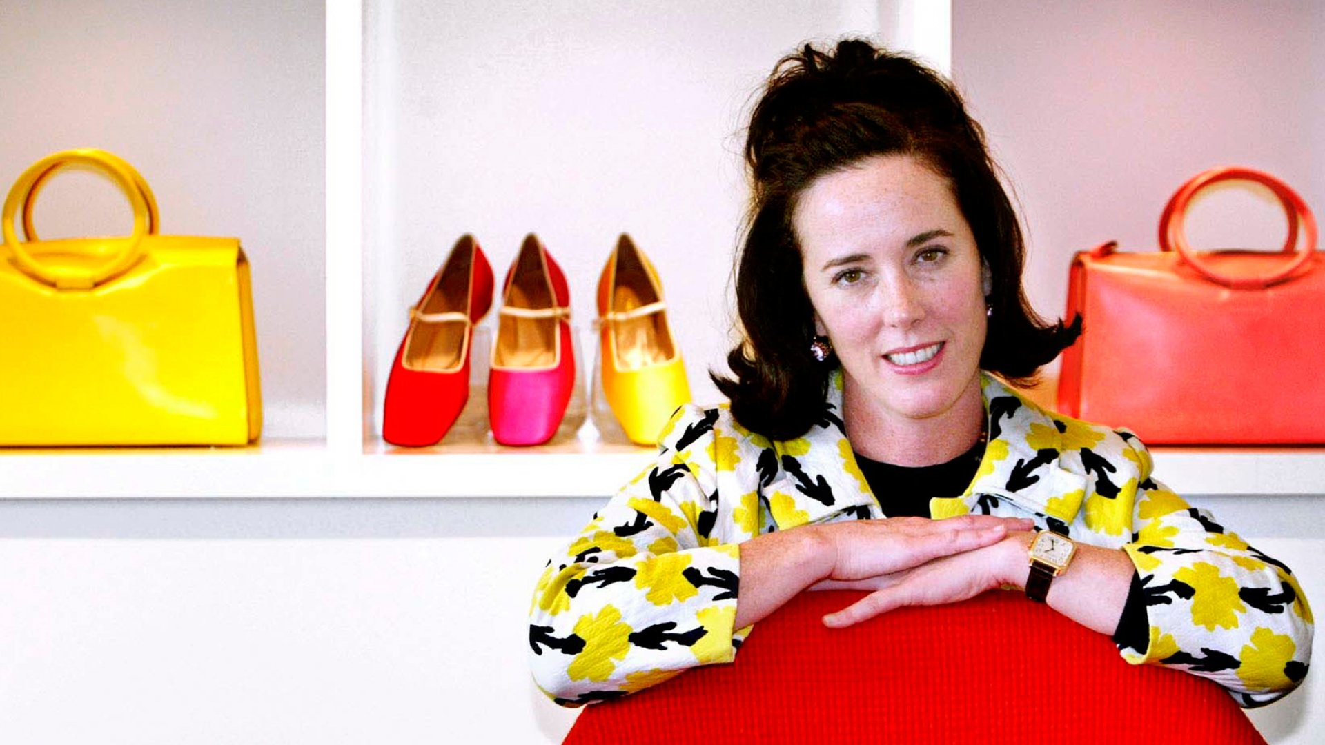 In this May 13, 2004 file photo, designer Kate Spade poses with handbags and shoes from her next collection in New York.