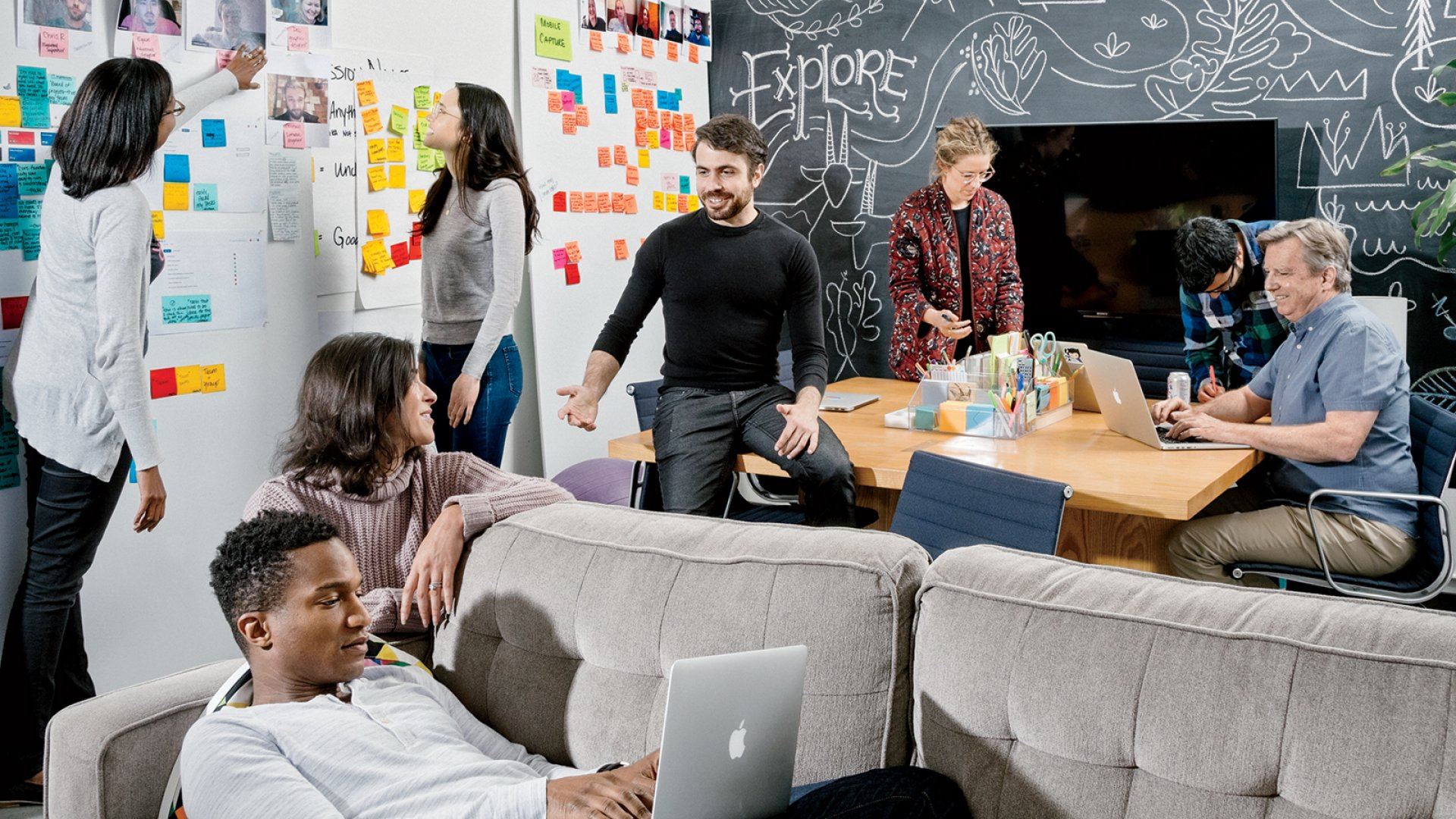 "Co-founder Justin Rosenstein (in black) and co-workers at Asana, where the setting is collaborative and cushy, but every decision is ""owned"" by one individual."