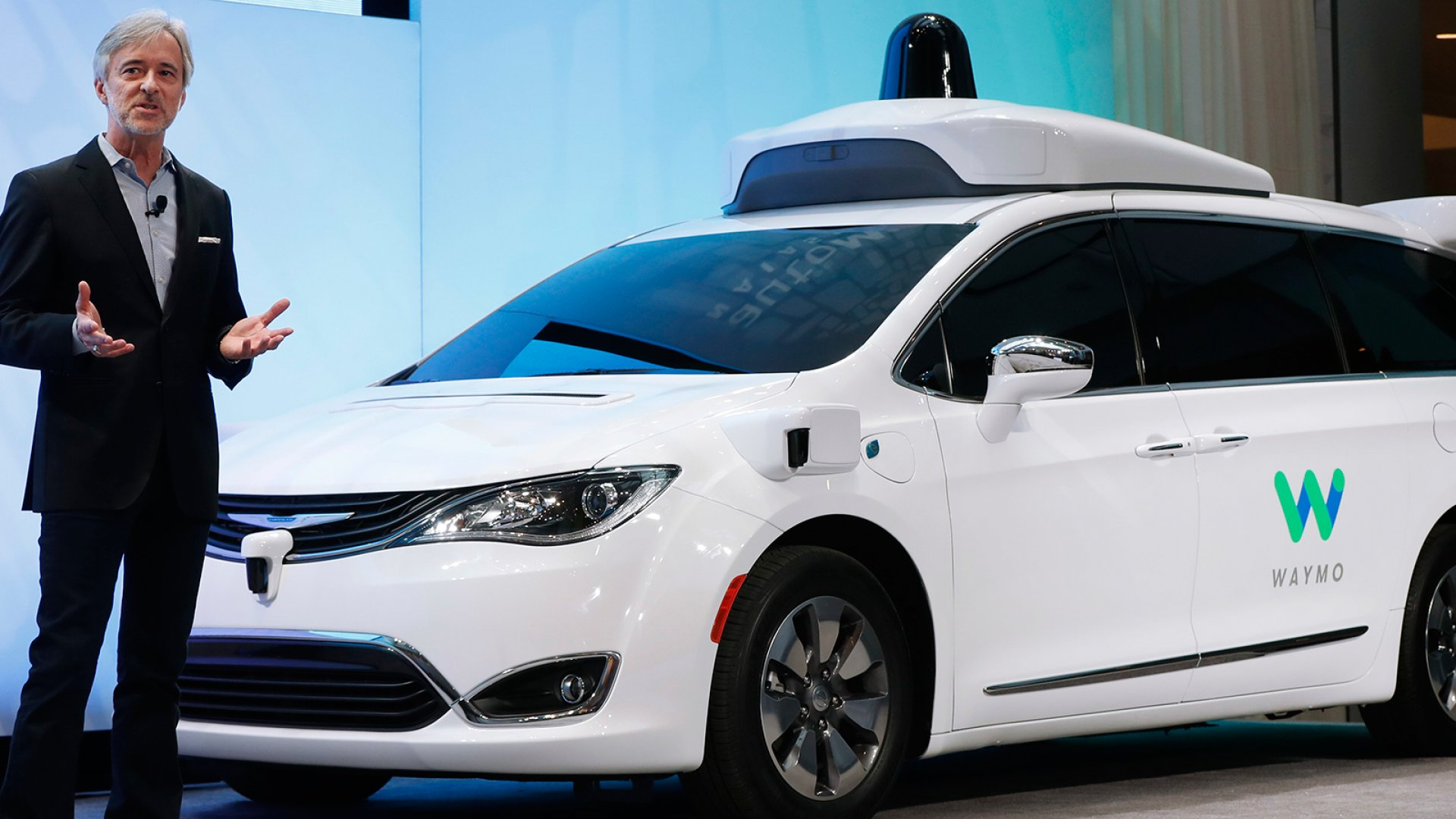 John Krafcik, CEO of Waymo, the autonomous vehicle company created by Google's parent company, Alphabet introduces a Chrysler Pacifica hybrid outfitted with Waymo's own suite of sensors and radar at the North American International Auto Show in Detroit, Sunday, Jan. 8, 2017.