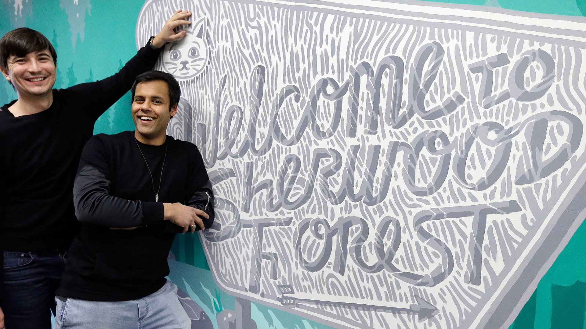 "Robinhood co-founders Vlad Tenev, left, and Baiju Bhatt pose at company headquarters in Palo Alto, Calif. Robinhood is a stock brokerage that does not charge any commissions for its more than 1 million customers to buy and sell shares. ""During the next 10 years, we are going to create an international company that will be like nothing the financial services industry has ever seen,"" says Bhatt."