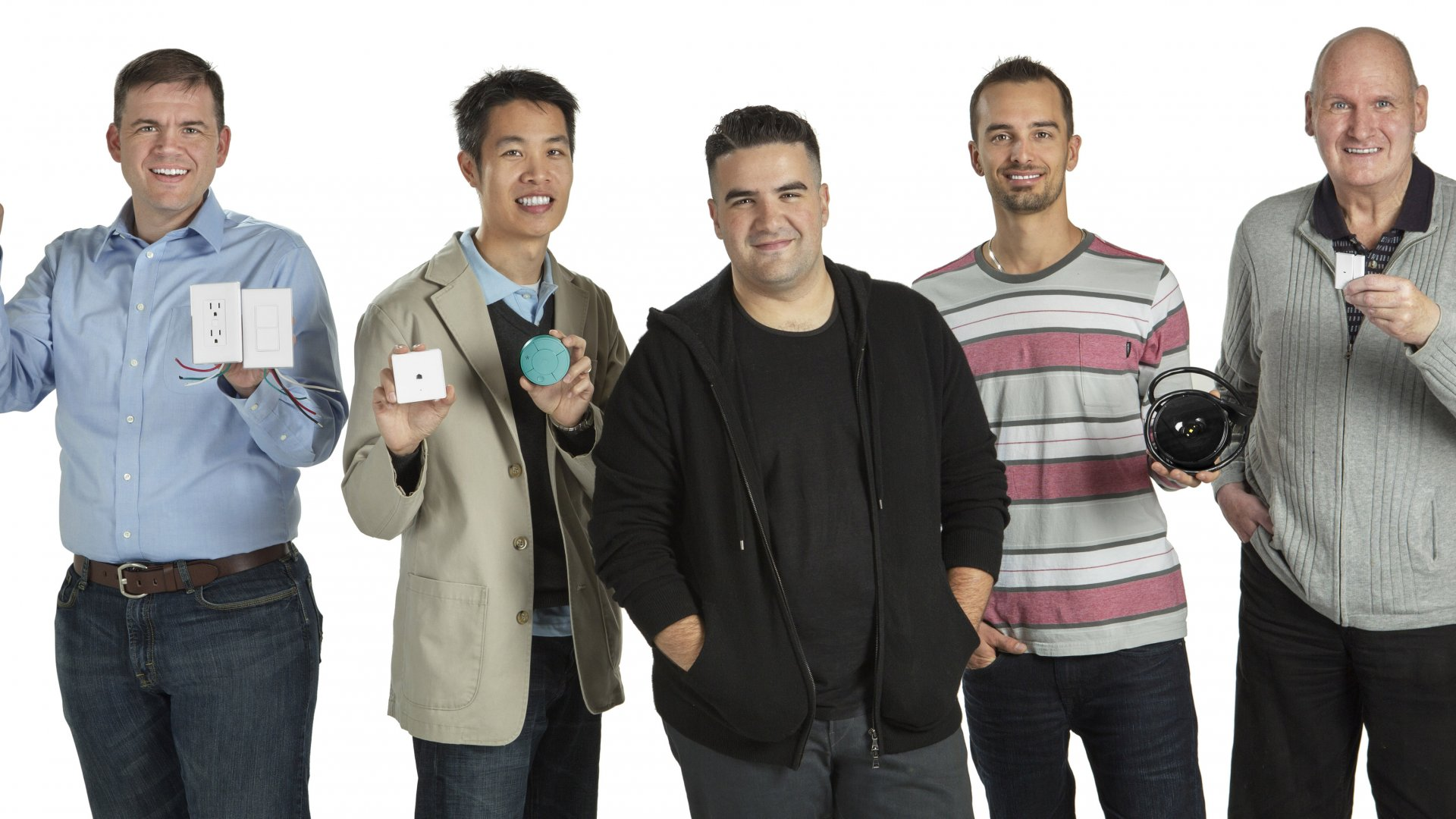 Ben Kaufman, founder and former CEO of Quirky, poses with inventors whose products were tweaked by other Quirky users before being prototyped and produced with help from the company.