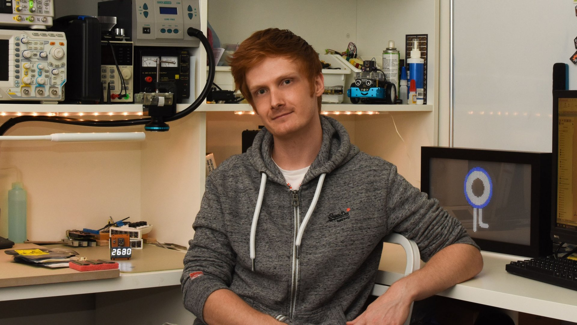 Blair Wyatt in his home lab, where he developed his Kickstarter project, the Social Distancing Badge.