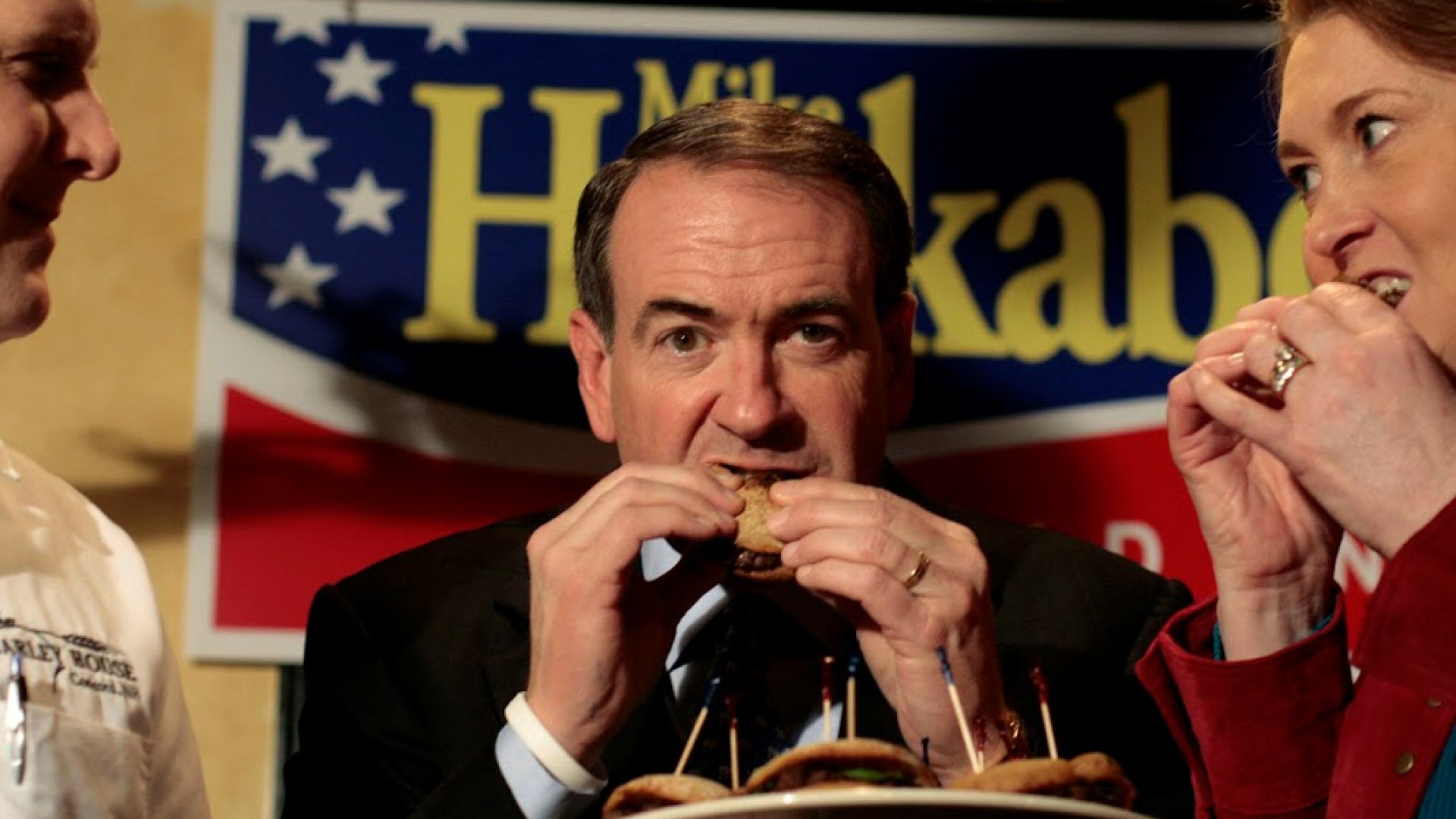 Former Arkansas governor Mike Huckabee eating a burger named after him at The Barley House, in Concord, New Hampshire.