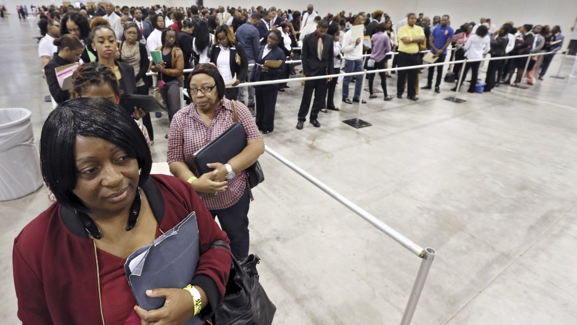 Kanockwa Horton, left, from Stone Mountain, and Jacqueline Merritt, from Atlanta, stand first in line at the Airport Community Job Fair, in Atlanta, joined by hundreds of other applicants in line before the 10 a.m. opening.