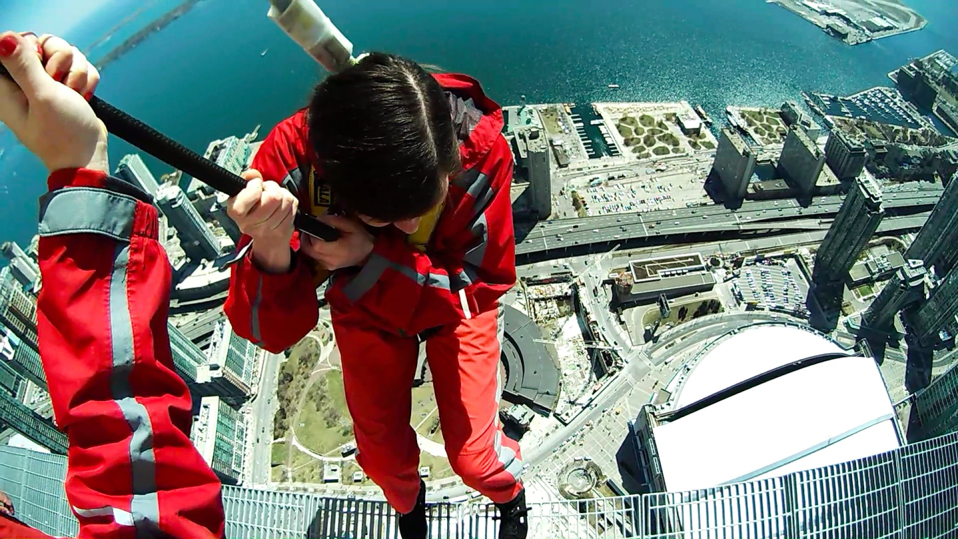Sociologist Margee Kerr embarks on a trust walk 1,168 feet above the earth on the CN Tower EdgeWalk in Toronto.