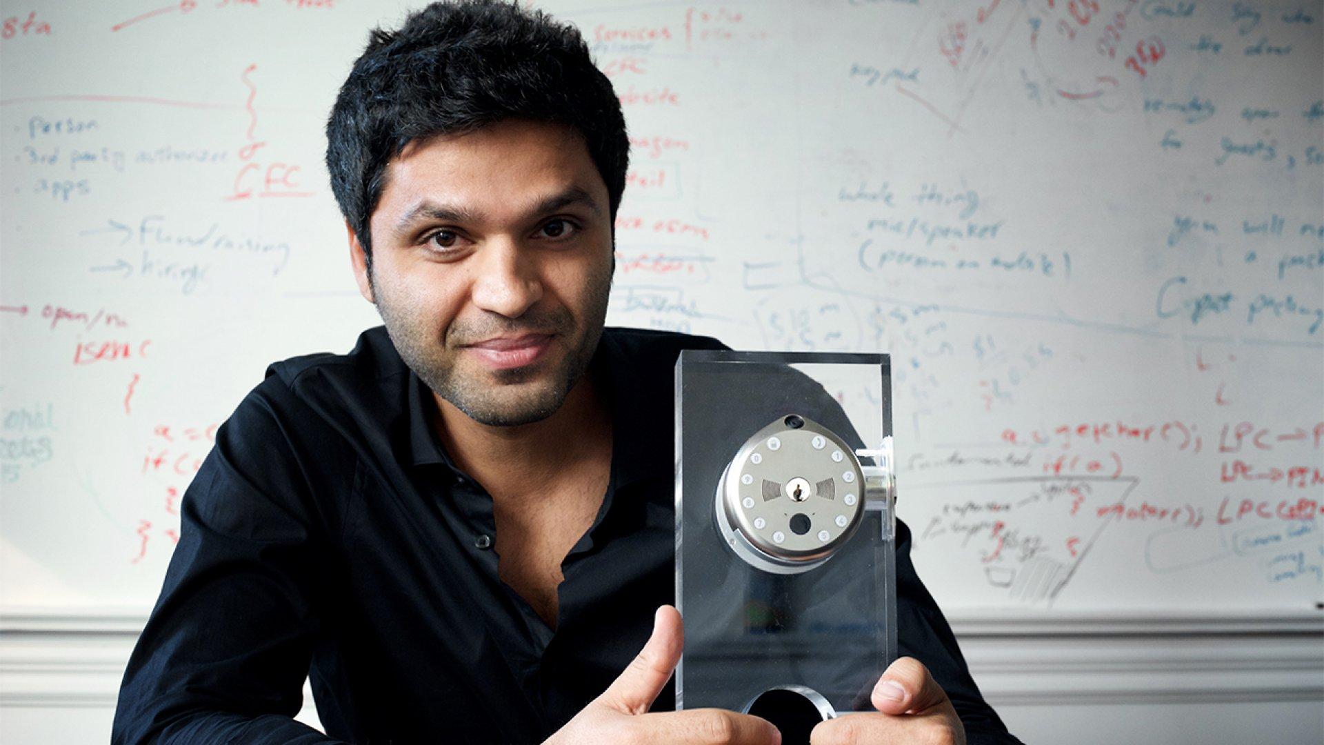 Founder Ehsan Saeedi holding a Gate smart lock unit.