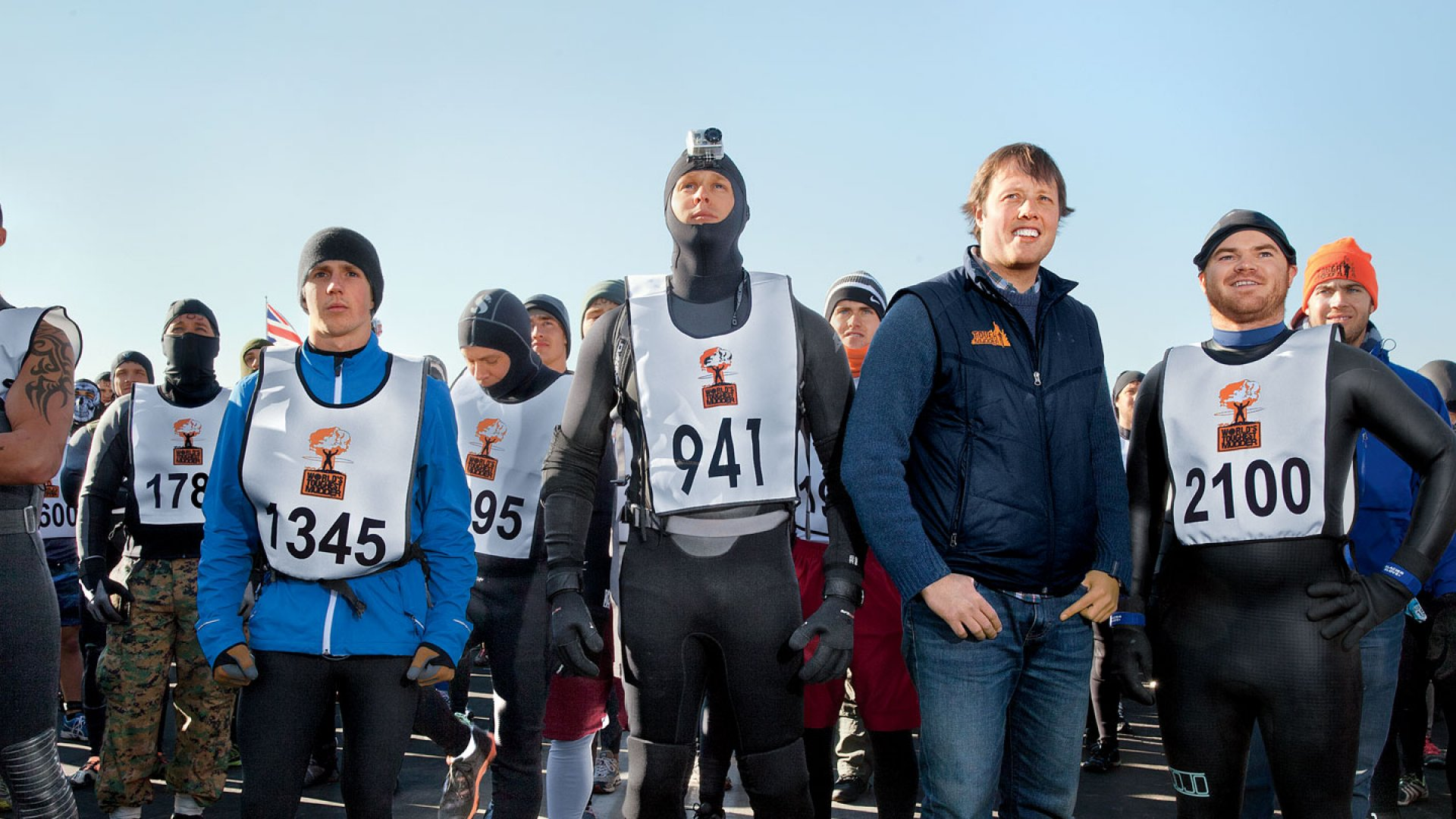 <b>Ready for Punishment:</b> About 1,000 racers joined co-founders Will Dean (second from right) and Guy Livingstone (right) in Englishtown, New Jersey, for World's Toughest Mudder, a 24-hour race that is the company's most grueling challenge.