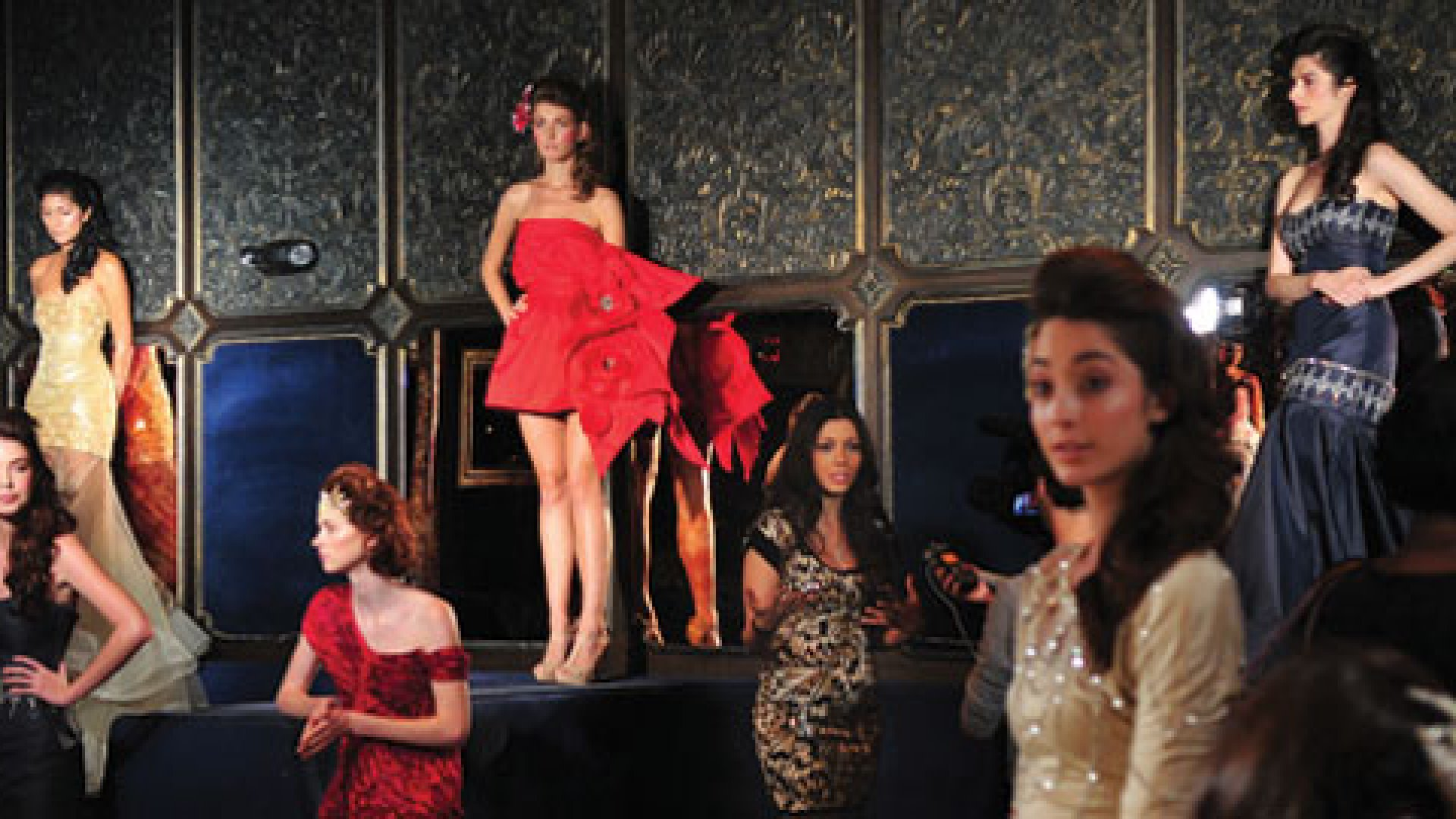 Designer and Project Runway winner Irina Shabayeva (right of girl in red) stands amongst her models during her Spring 2011 presentation for Fashion Week at The Griffin in New York City.