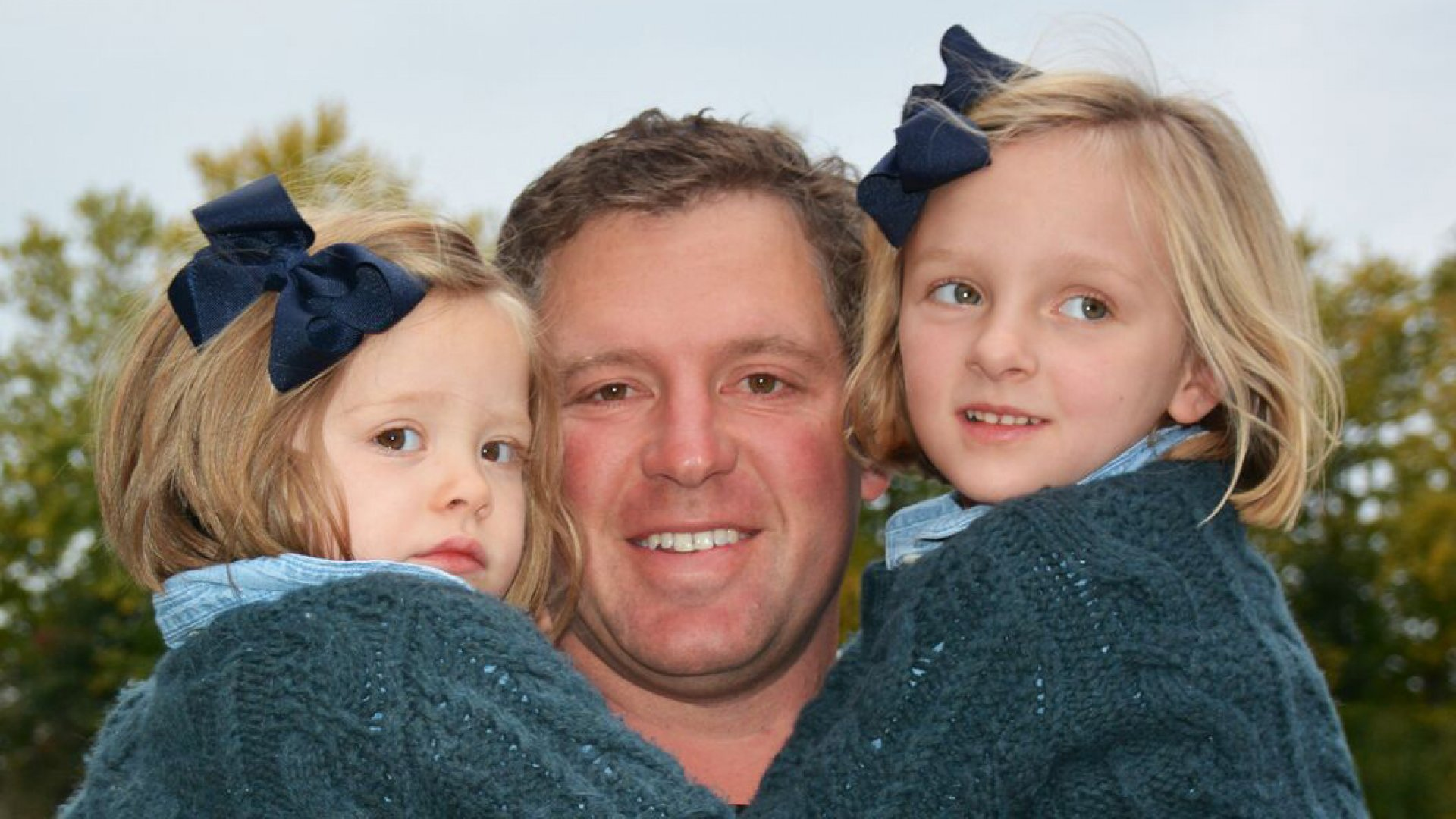 GoHealth president Brandon Cruz with his two daughters.