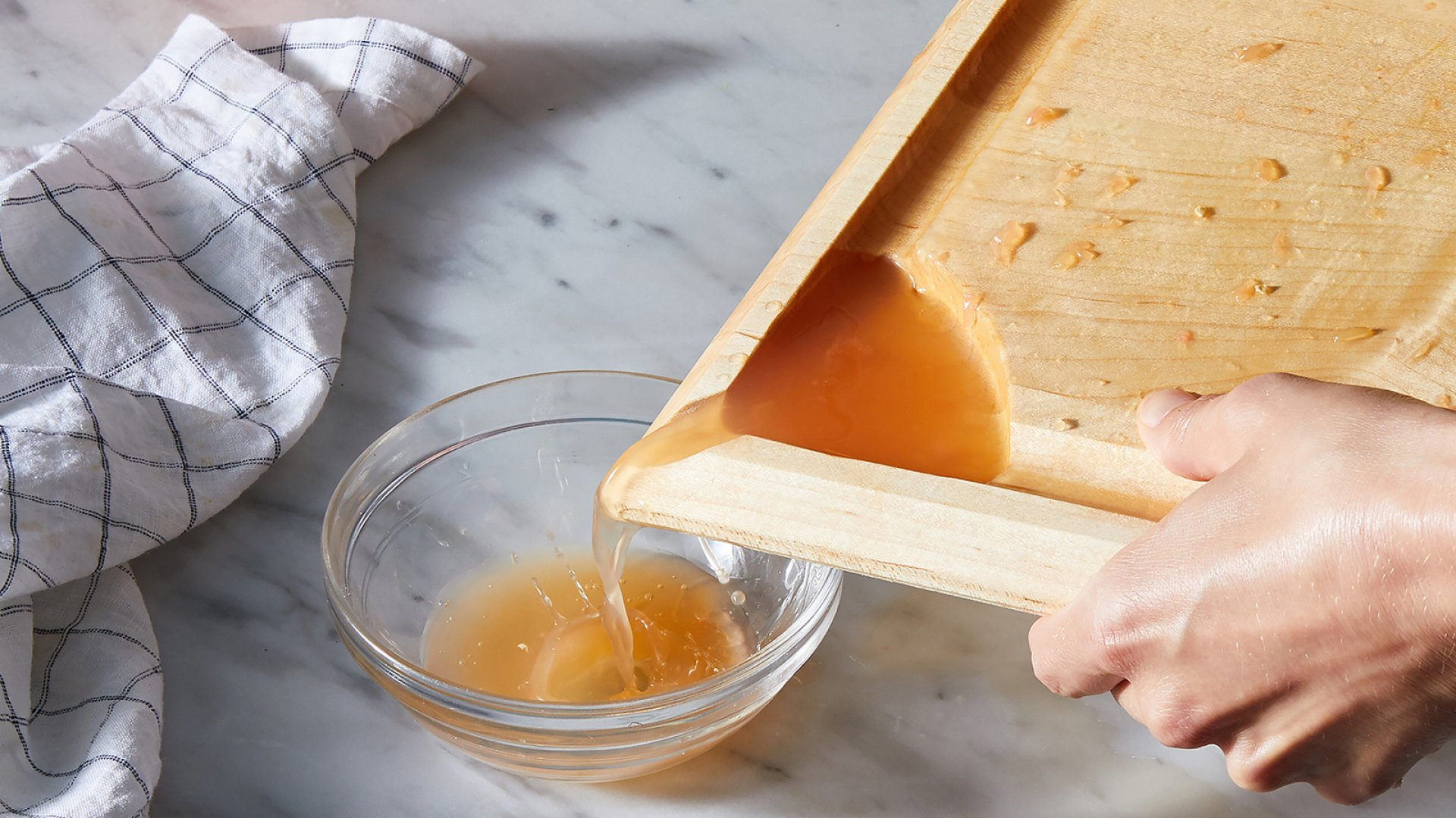 The Food52 cutting board was designed with deep grooves and a spout to collect and pour residual juices.