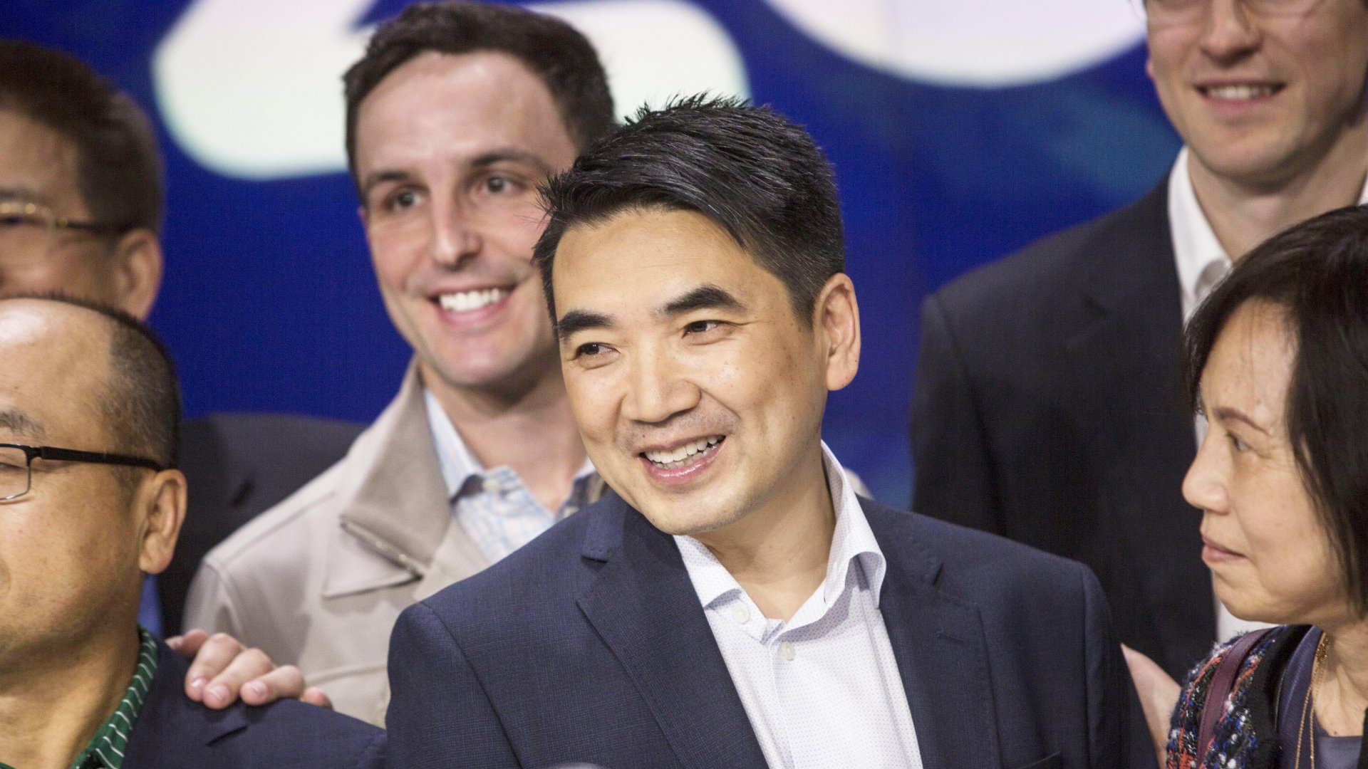 Eric Yuan, founder and CEO of Zoom (center), rings the opening bell during the company's IPO at the Nasdaq MarketSite on April 18, 2019.