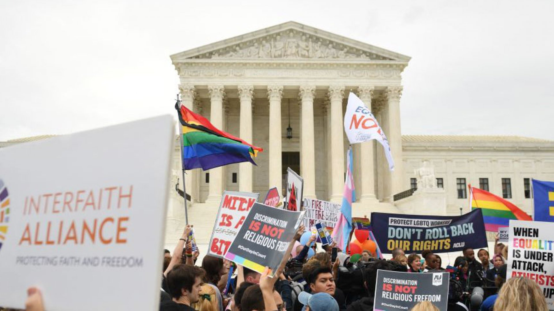 Demonstrators in favor of LGBT rights rally outside the US Supreme Court in Washington, DC