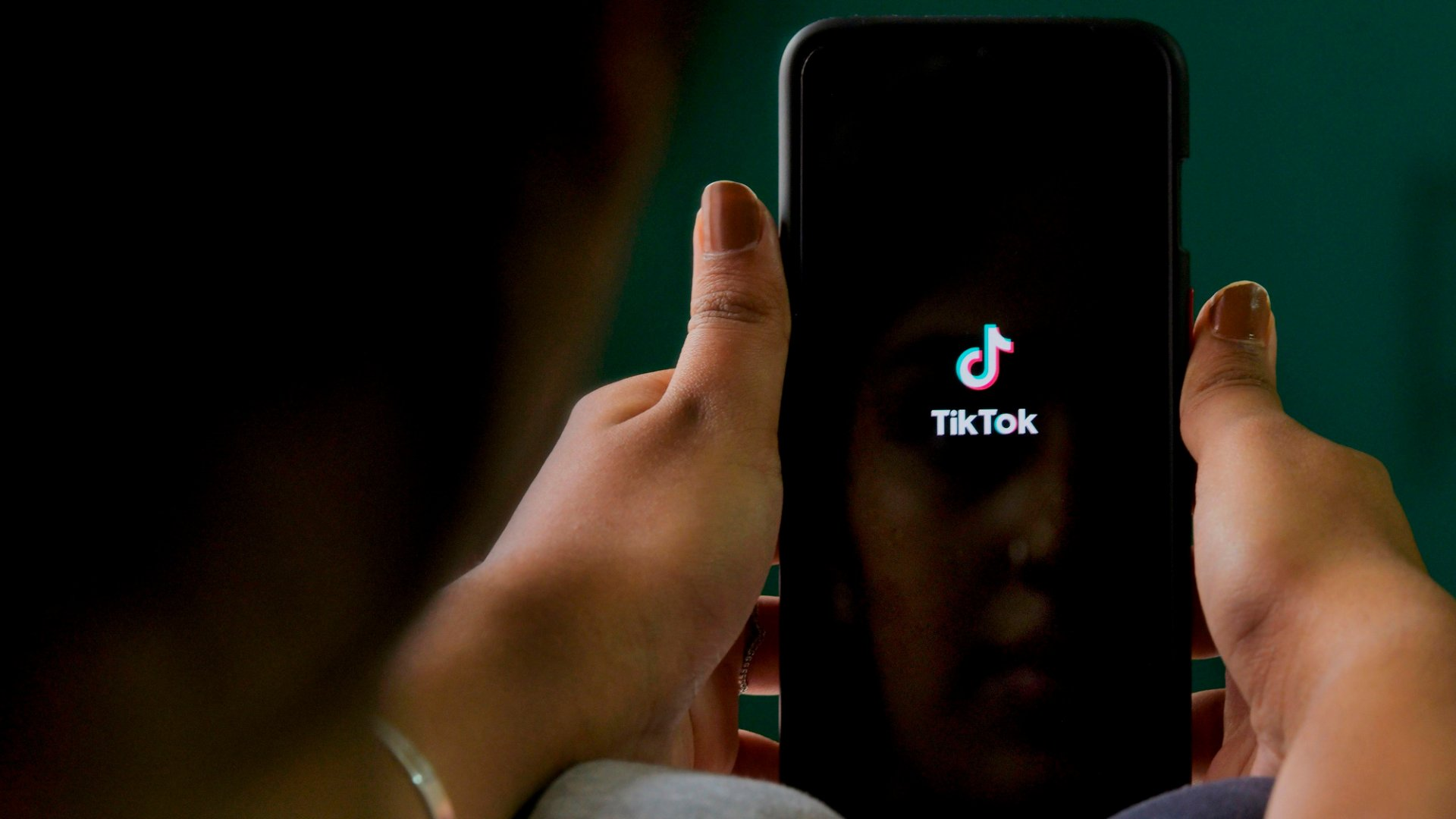 A mobile user browses through the Chinese-owned TikTok app on a smartphone in Bangalore, India. TikTok on June 30 denied sharing information on Indian users with the Chinese government, after New Delhi banned the wildly popular app, citing national security and privacy concerns.