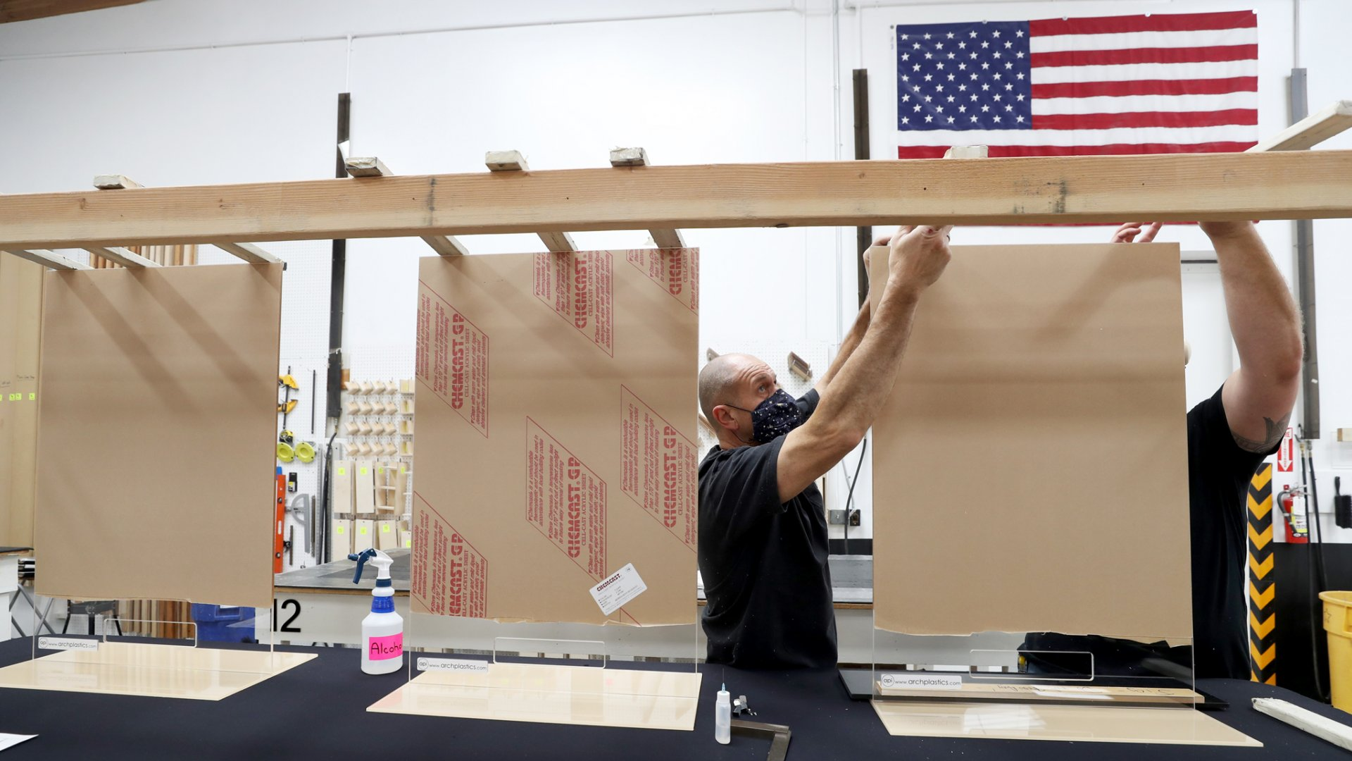 Architectural Plastics assembles acrylic sheets that will be used for social-distancing guards for businesses on May 7, 2020 in Petaluma, California.