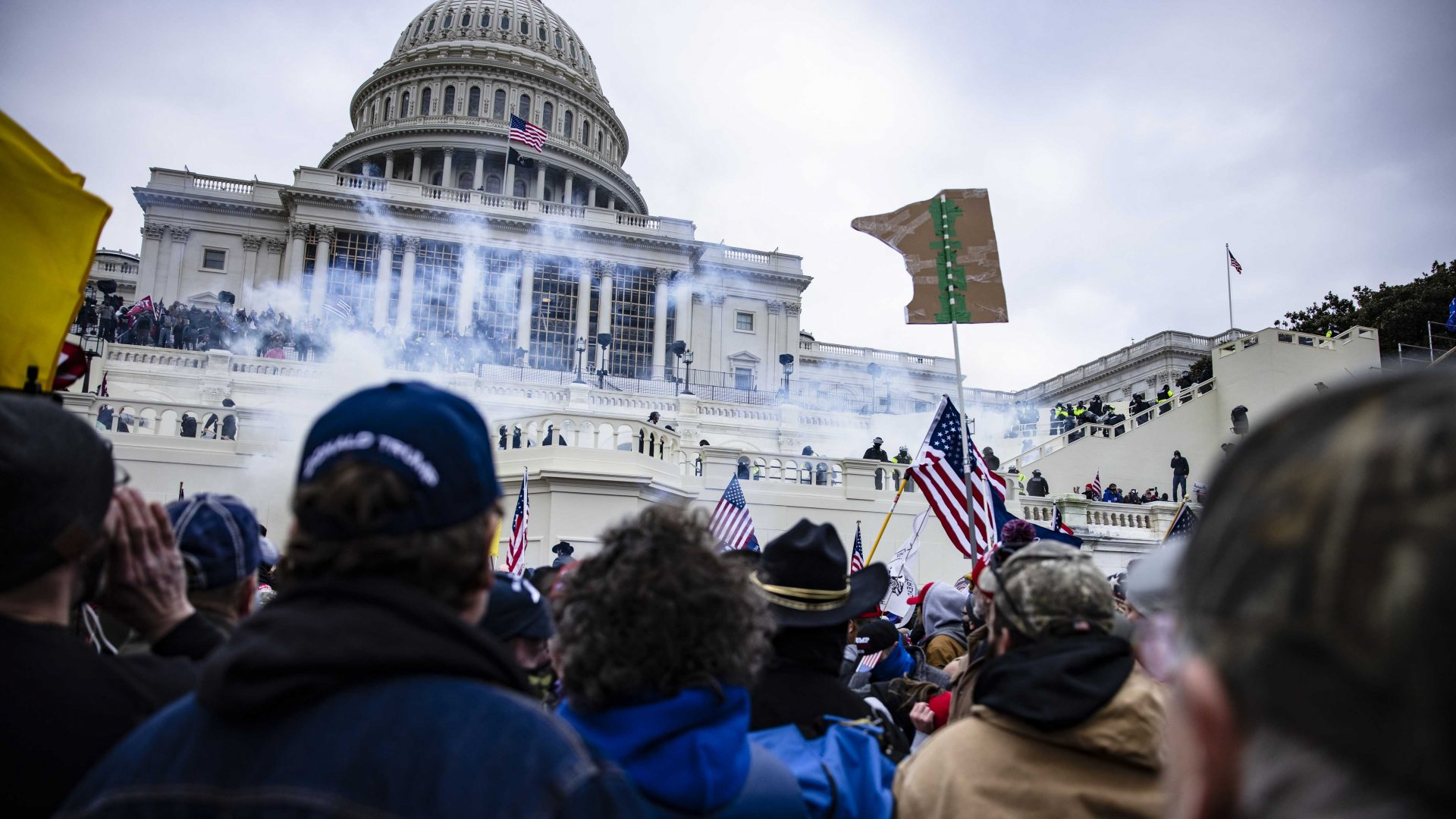 A mob enraged by the ratification of President-elect Joe Biden's Electoral College victory over President Trump in the 2020 election storms the U.S. Capitol following a rally led by Trump on January 6, 2021.