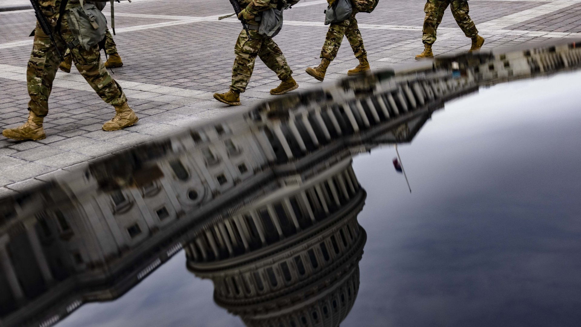 Virginia National Guard soldiers march at the U.S. Capitol on their way to their guard posts on January 16, 2021, in Washington, D.C. After last week's riots at the U.S. Capitol Building, the FBI has warned of additional threats in the nation's capital and in all 50 states. According to reports, as many as 25,000 National Guard soldiers will be guarding the city as preparations are made for the inauguration of Joe Biden as the 46th U.S. president.