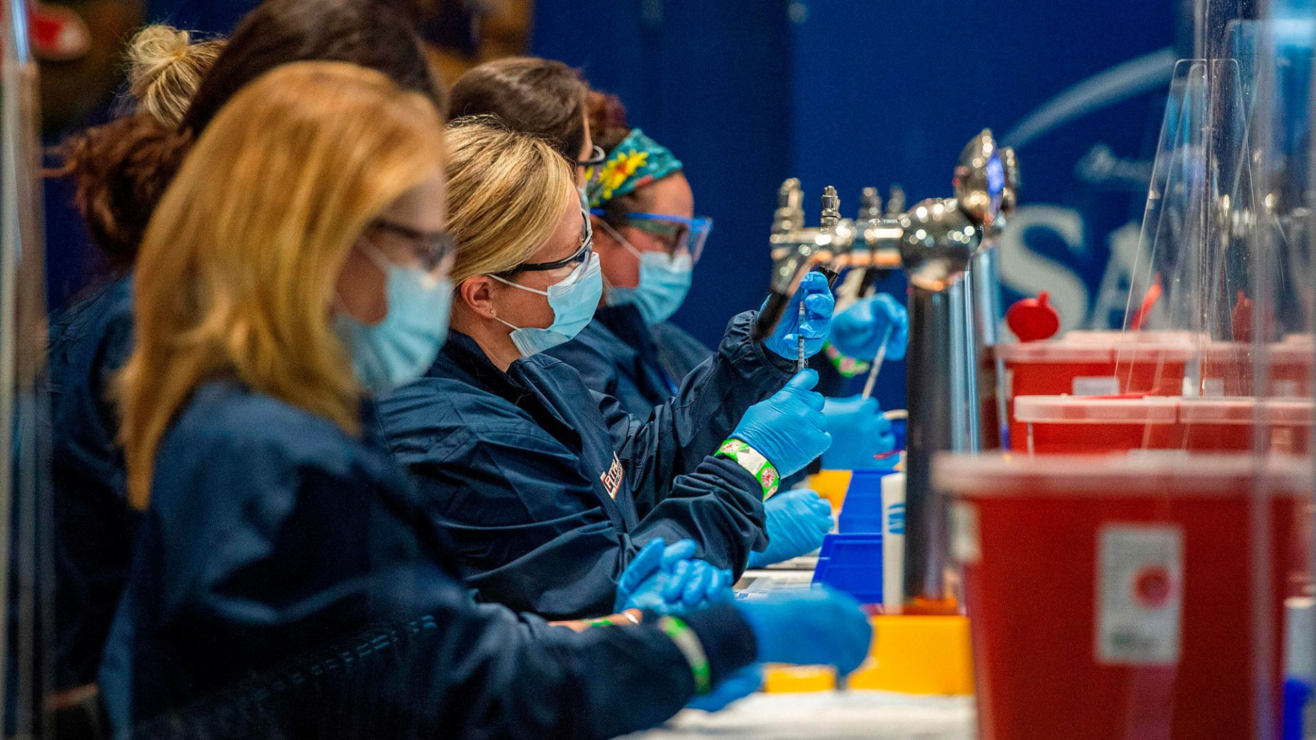 Medical staff workers prepare syringes with doses of the Covid-19 vaccine at Fenway Park in Boston in January.
