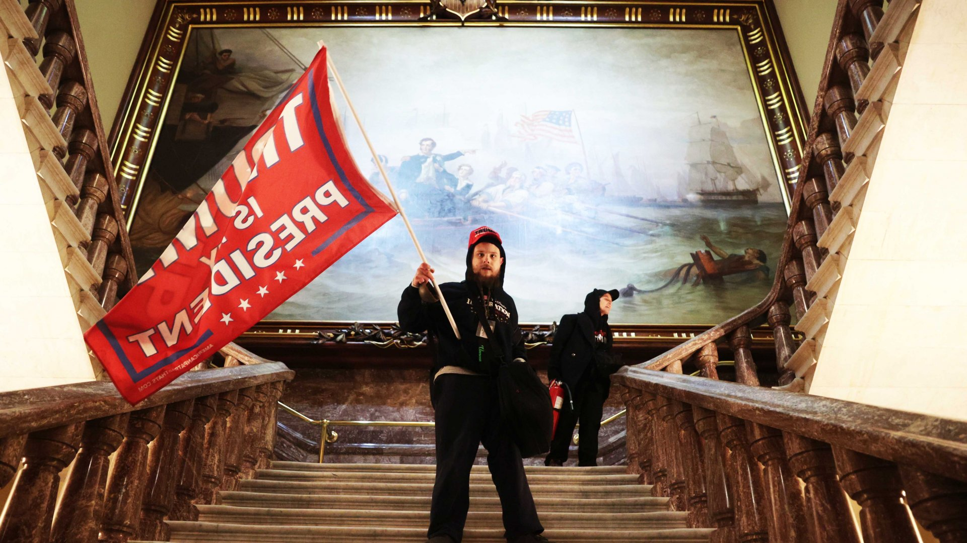 A protester holds a Trump flag inside the U.S. Capitol on January 6, 2021, disrupting Congress during a joint session to ratify President-elect Joe Biden's 306-232 Electoral College win over President Donald Trump.