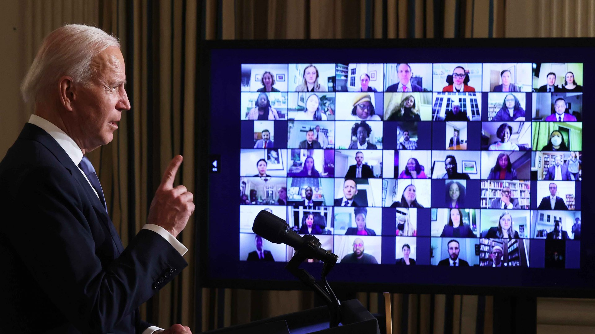 President Joe Biden conducts a virtual swearing-in ceremony for members of his new administration via Zoom just hours after his inauguration in the State Dining Room at the White House, January 20, 2021, in Washington, D.C.