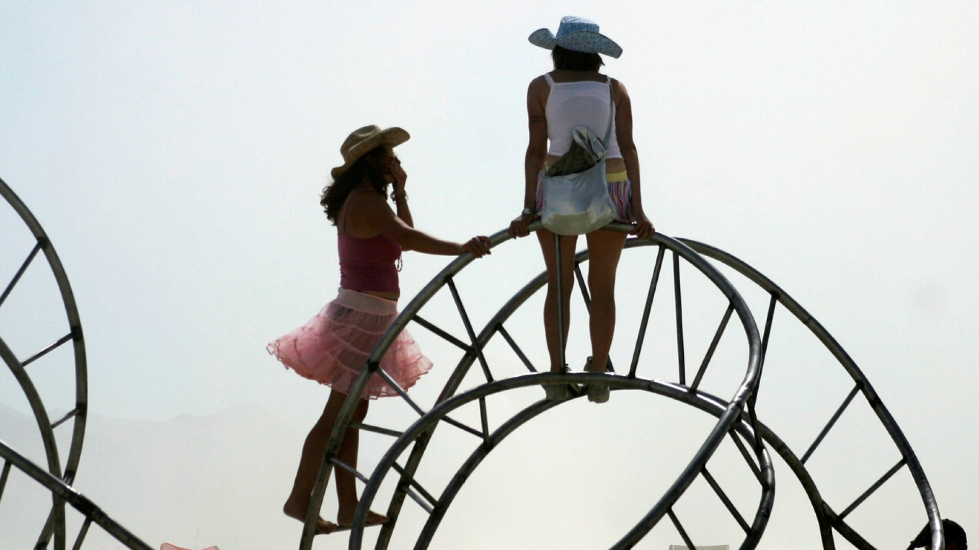 Two Burning Man attendees, possibly learning some leadership skills.