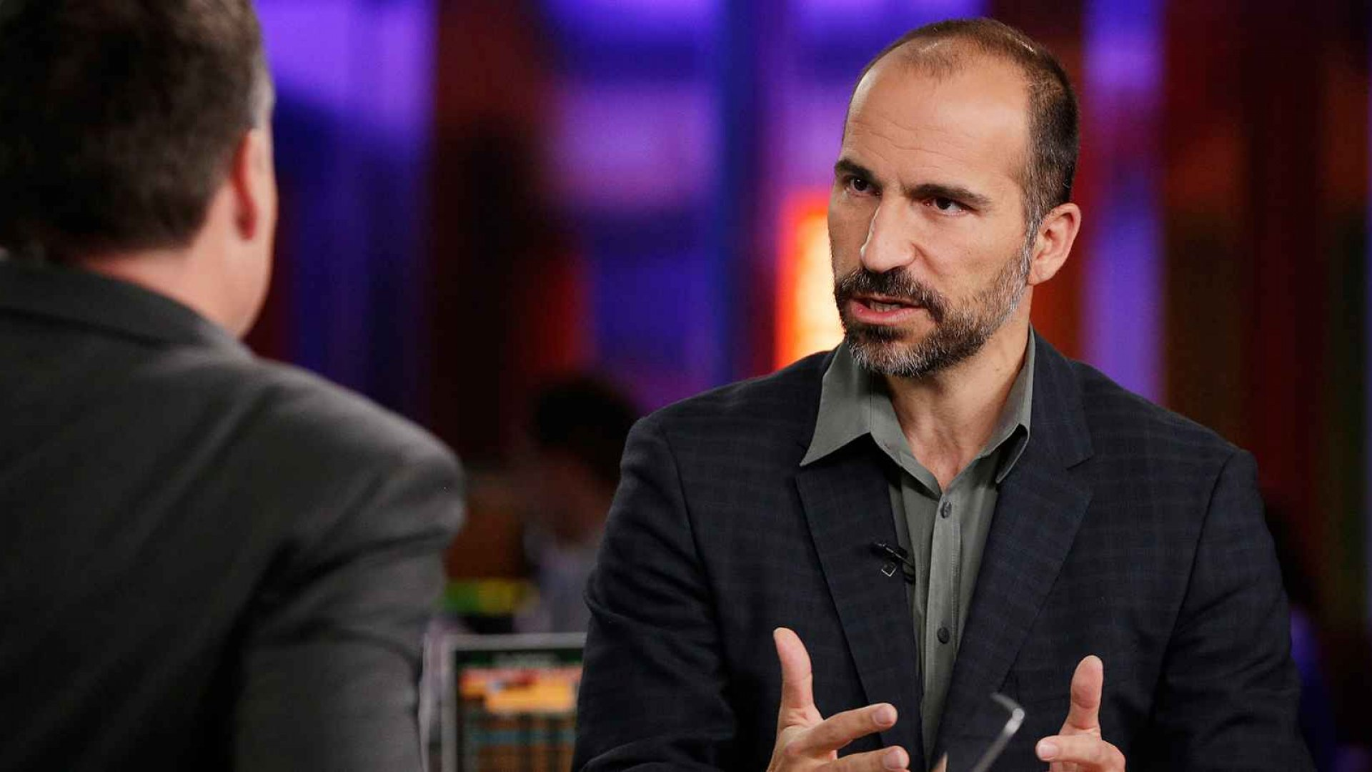 Uber CEO Dara Khosrowshahi (right).