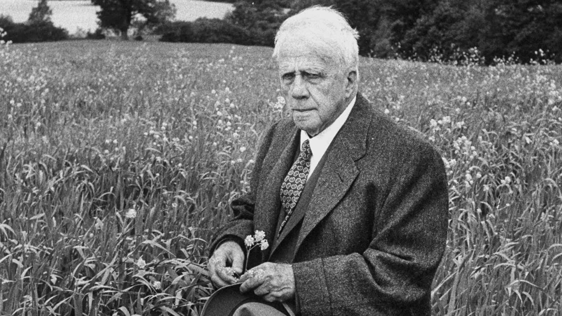 American poet, Robert Frost standing in meadow during visit to the Gloucester area of England where he lived as an expatriate poet.