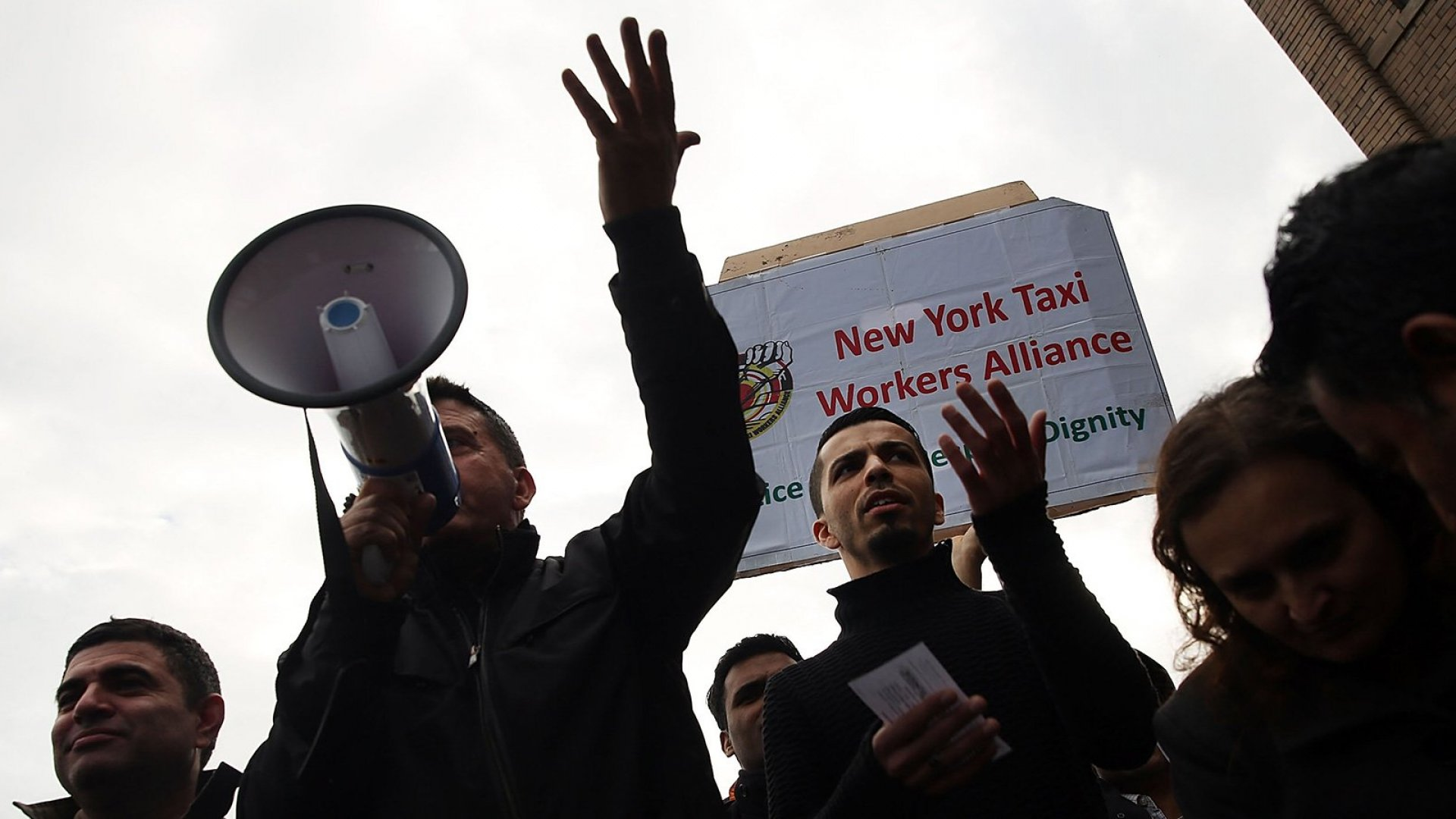 Uber driver representatives speak out at a protest in New York City in 2016.