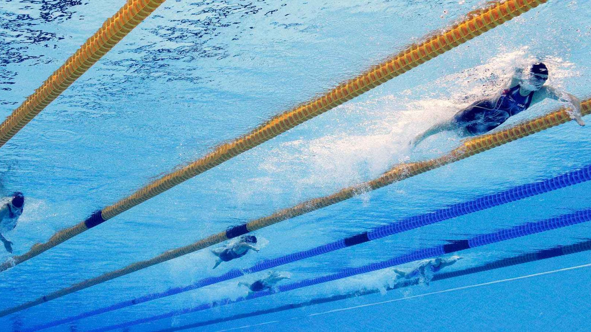 Katie Ledecky (right) of the United States competes in the Women's 400m Freestyle Final.